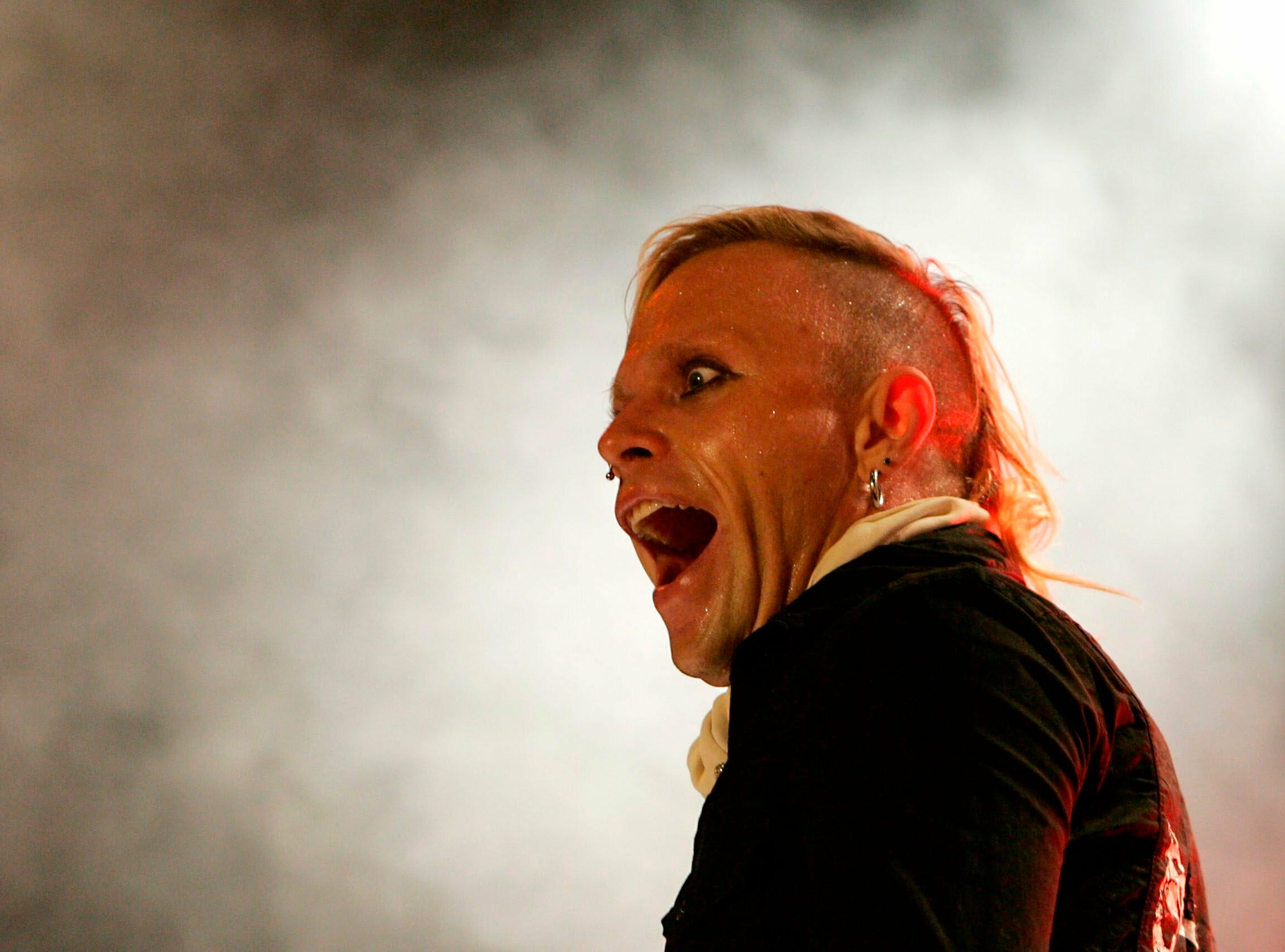 In this file photo dated Friday, July 15, 2005, Keith Flint, singer of the British band Prodigy, performs on stage, at the Gurten open air Festival in Bern, Switzerland. The Progidy front man Flint is reported to have died at his home in London, according to a statement by the band Monday March 4, 2019.