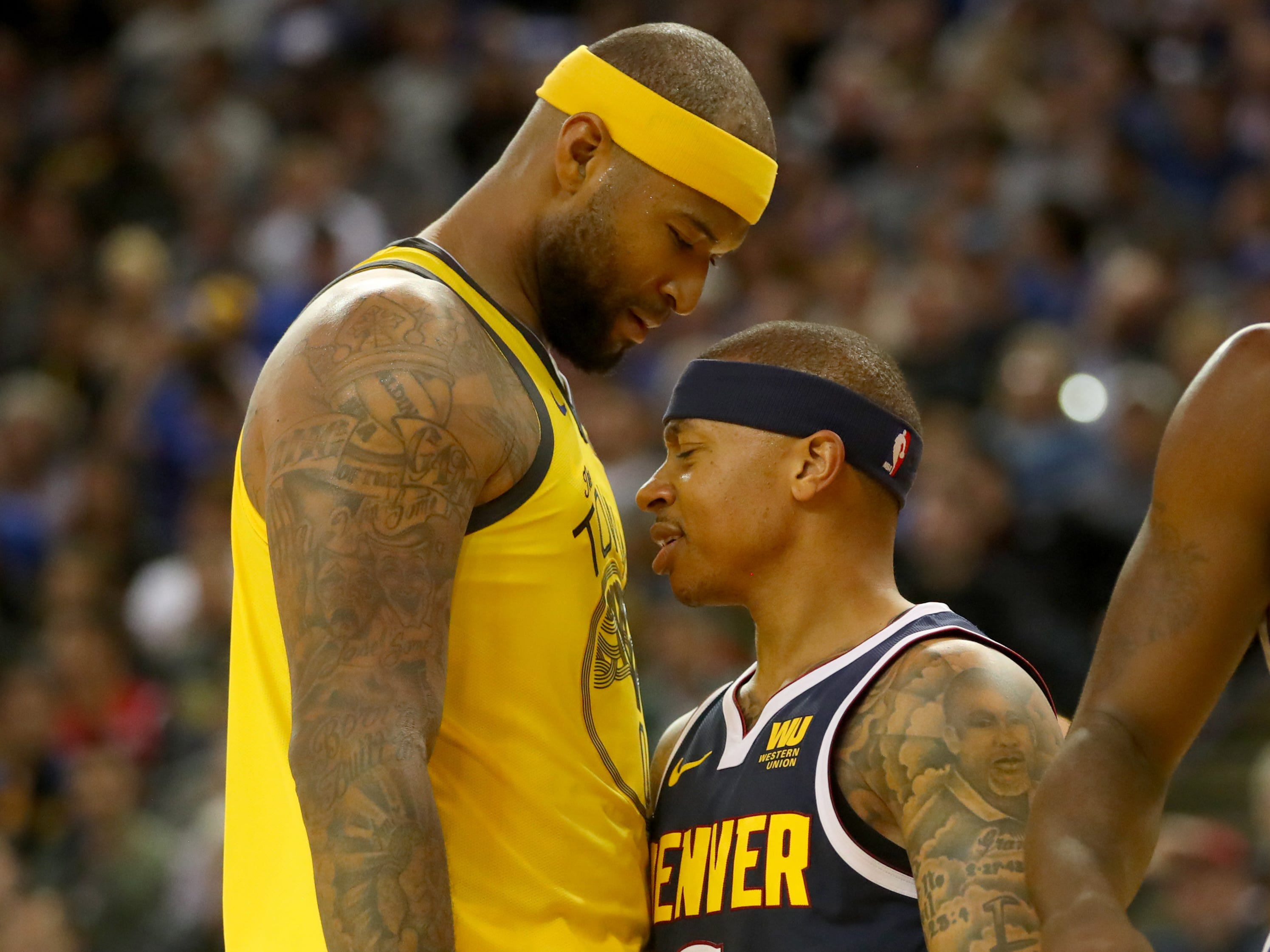 March 8: Warriors center DeMarcus Cousins (0) exchanges words with Nuggets guard Isaiah Thomas (0) during the fourth quarter at Oracle Arena in Oakland.