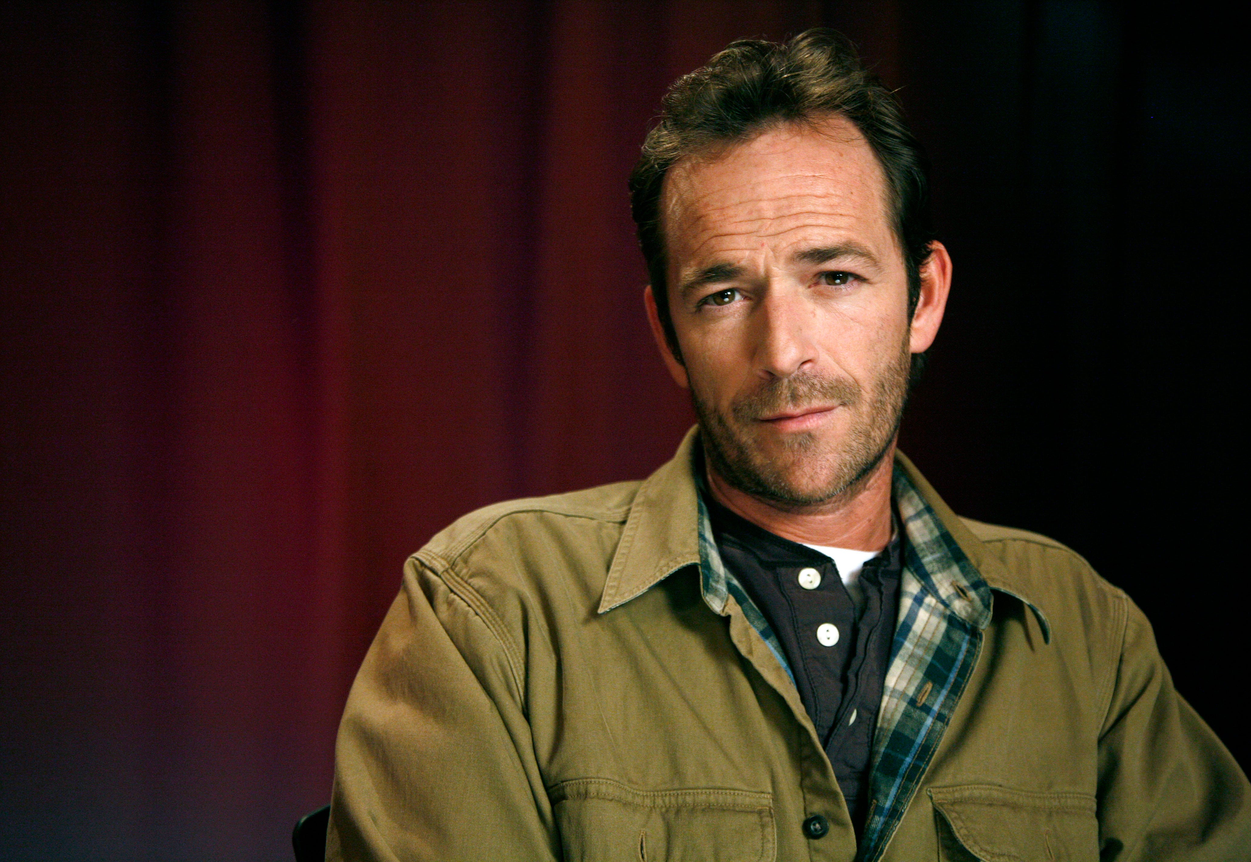 """In this Jan. 26, 2011 file photo, actor Luke Perry poses for a portrait in New York. Perry, who gained instant heartthrob status as wealthy rebel Dylan McKay on """"Beverly Hills, 90210,"""" died Monday, March 4, 2019, after suffering a massive stroke, his publicist said. He was 52."""