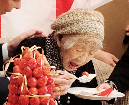 Kane Tanaka, a 116-year-old Japanese woman, celebrates with the official recognition of Guinness World Records' world's oldest verified living person in Fukuoka on March 9, 2019.