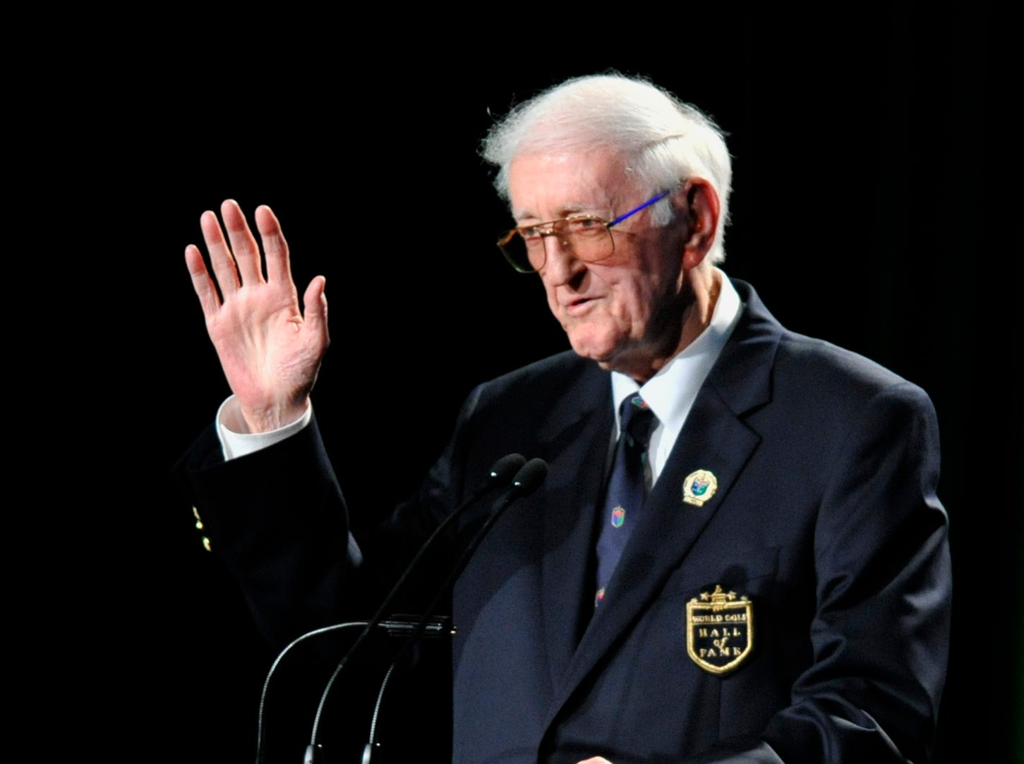 In this May 7, 2012, file photo, sports writer Dan Jenkins speaks after receiving the lifetime achievement award during the World Golf Hall of Fame inductions at World Golf Village in St. Augustine, Fla. Jenkins, the sports writing great and best-selling author known for his humor, has died. He was 89. TCU athletic director Jeremiah Donati confirmed Jenkins died Thursday, March 7, 2019, in his hometown of Fort Worth, Texas.