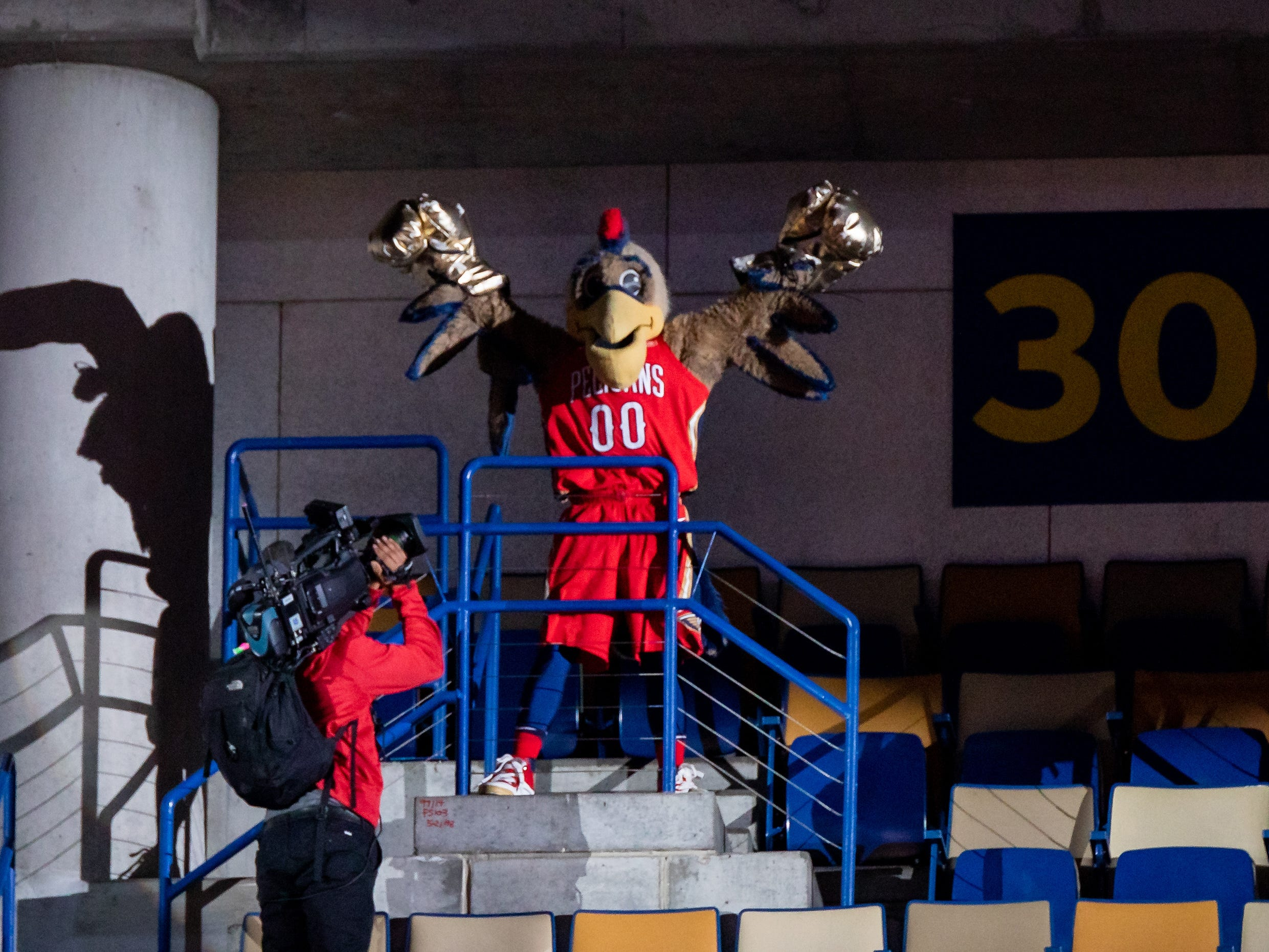 March 6: New Orleans Pelicans mascot Pierre T. Pelican stands at the top to the arena during a timeout against Utah Jazz during the second half at Smoothie King Center.