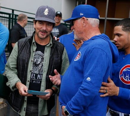 March 2: Chicago Cubs manager Joe Maddon and Eddie Vedder talk before a spring training game against the Milwaukee Brewers at Sloan Park.
