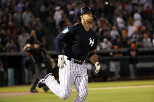 March 8: New York Yankees left fielder Giancarlo Stanton hits a 2-run home run during the first inning against the Detroit Tigers.