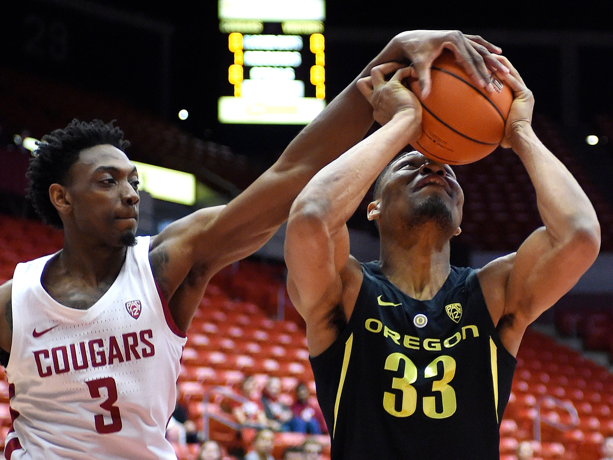 March 6: Oregon forward Francis Okoro has his shot blocked by Washington State's Robert Franks in the first half at Beasley Coliseum.