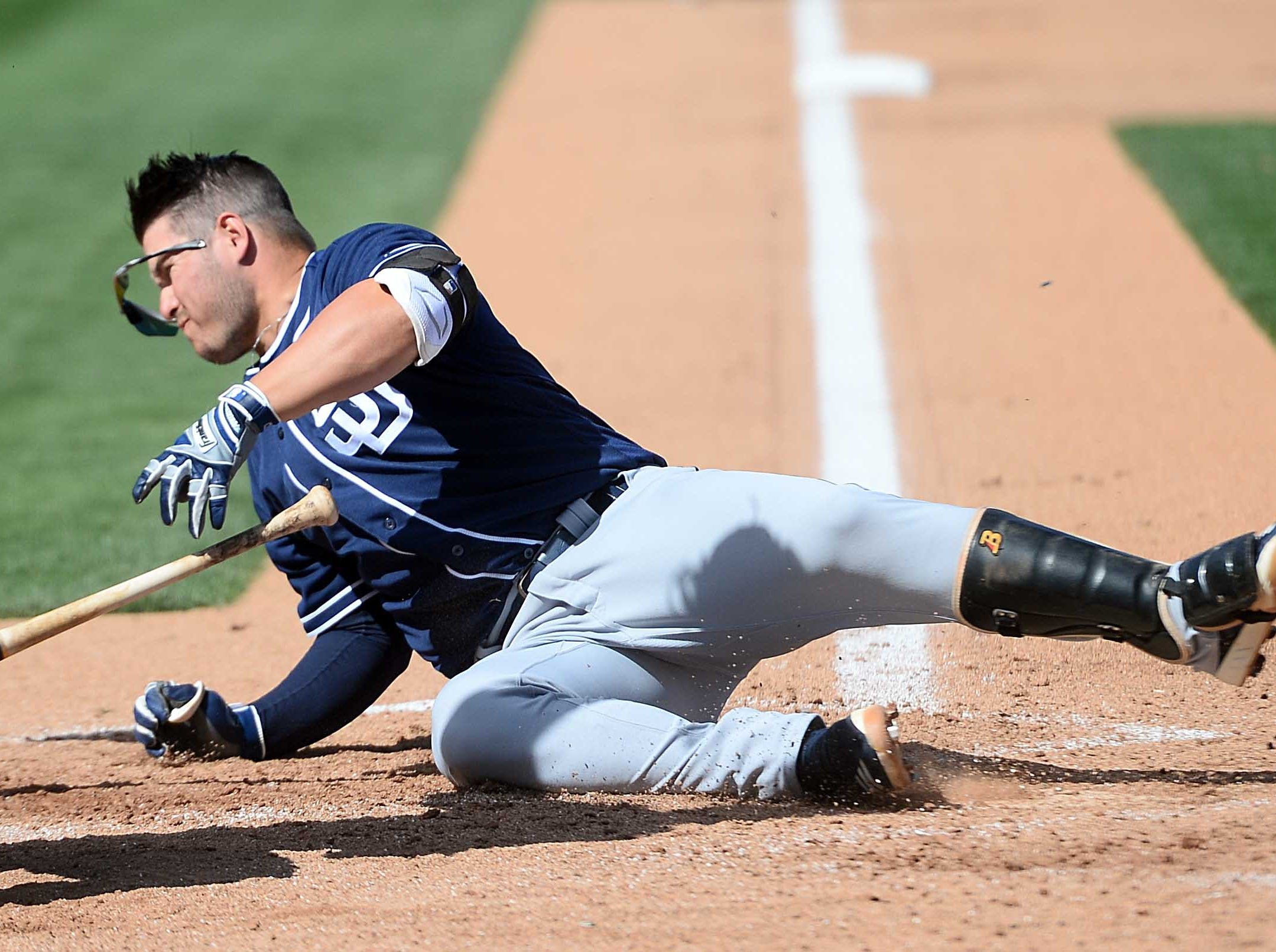 March 8: San Diego Padres first baseman Ty France hits the ground after being hit in the head with a pitch against the Oakland Athletics.