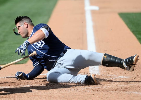 Then-San Diego Padres first baseman Ty France hits the ground after being hit in the head with a pitch against the Oakland Athletics.