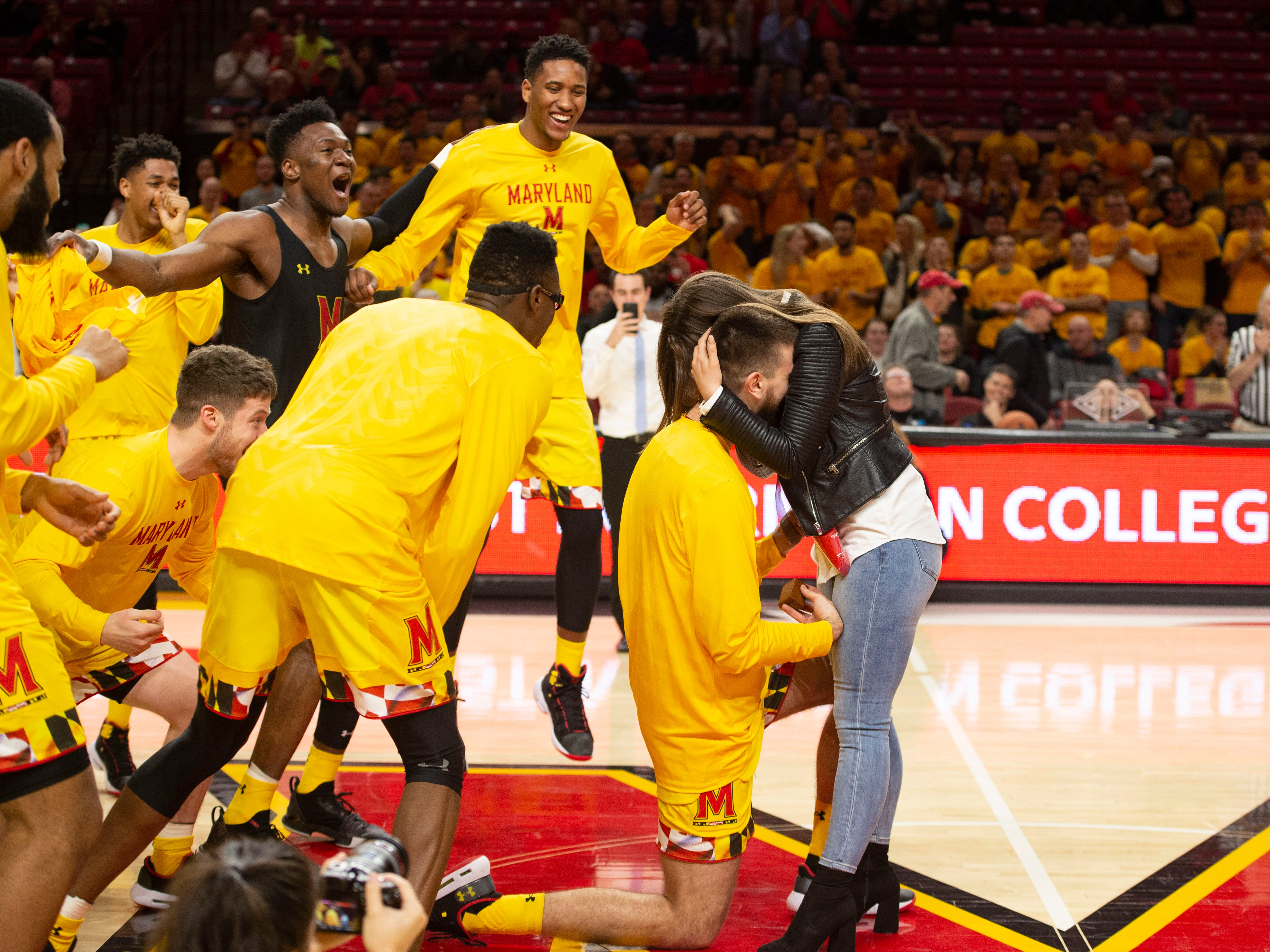 March 8: The Maryland Terrapins celebrate after forward Ivan Bender proposed to Andrea Knezevic on the court before the game against the Minnesota Golden Gophers at XFINITY Center.
