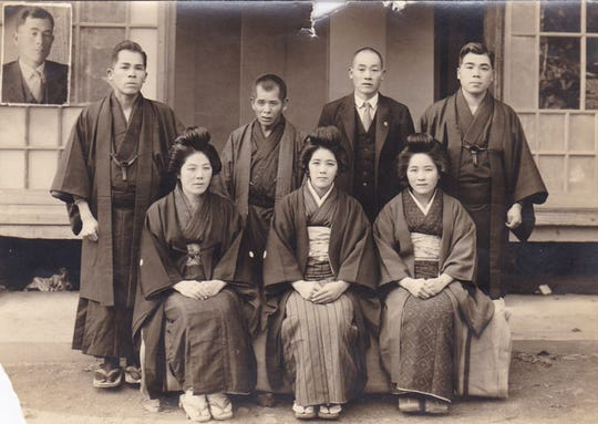 A younger Kane Tanaka, bottom row center, with her brothers and sisters.