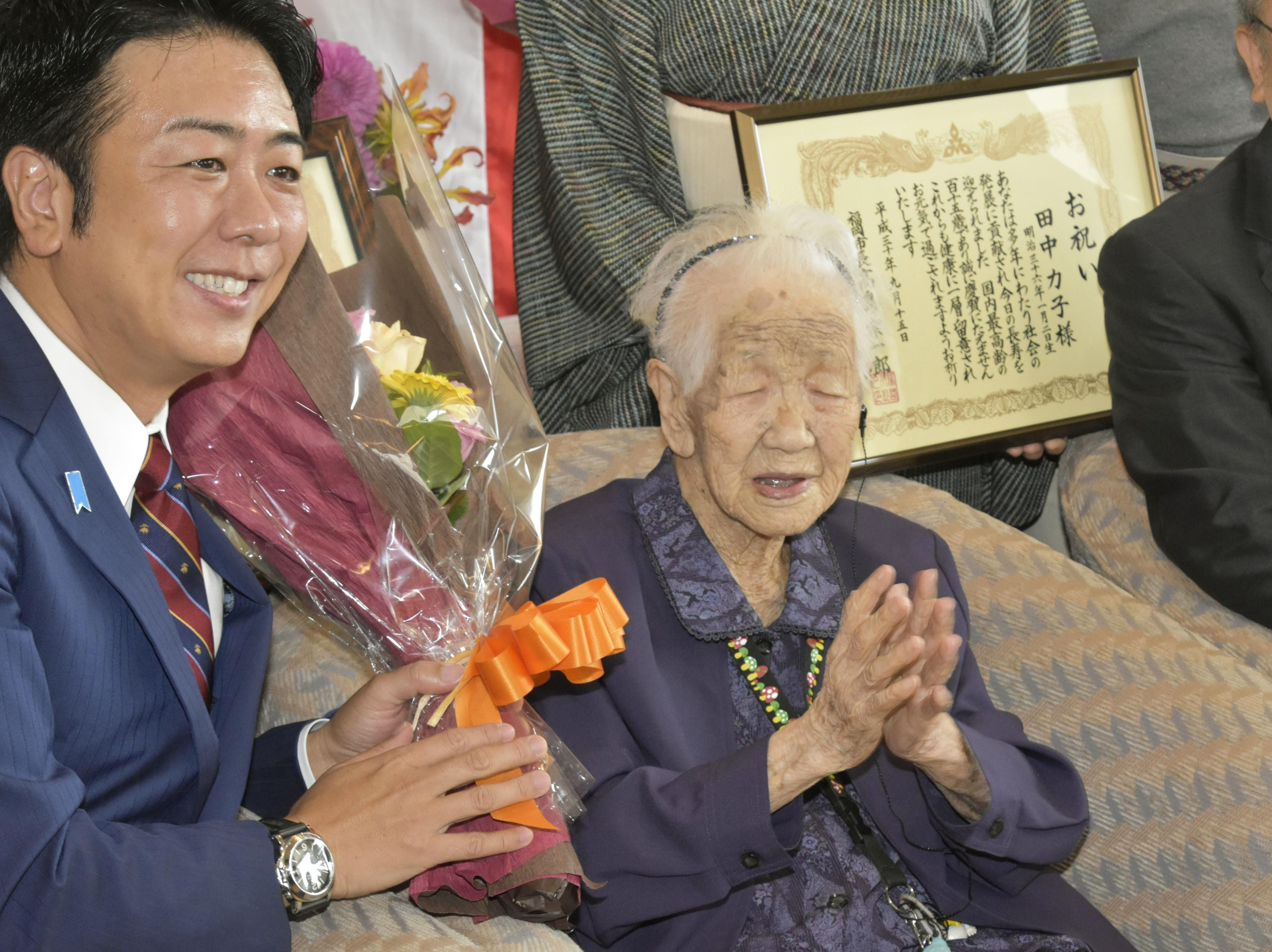 Japan's oldest living female, Kane Tanaka, 115, is honored by Fukuoka Mayor Soichiro Takashima, left, in Fukuoka on Sept. 14, 2018. Tanaka was born on Jan. 2, 1903, the year the Wright brothers flew the world's first powered airplane.