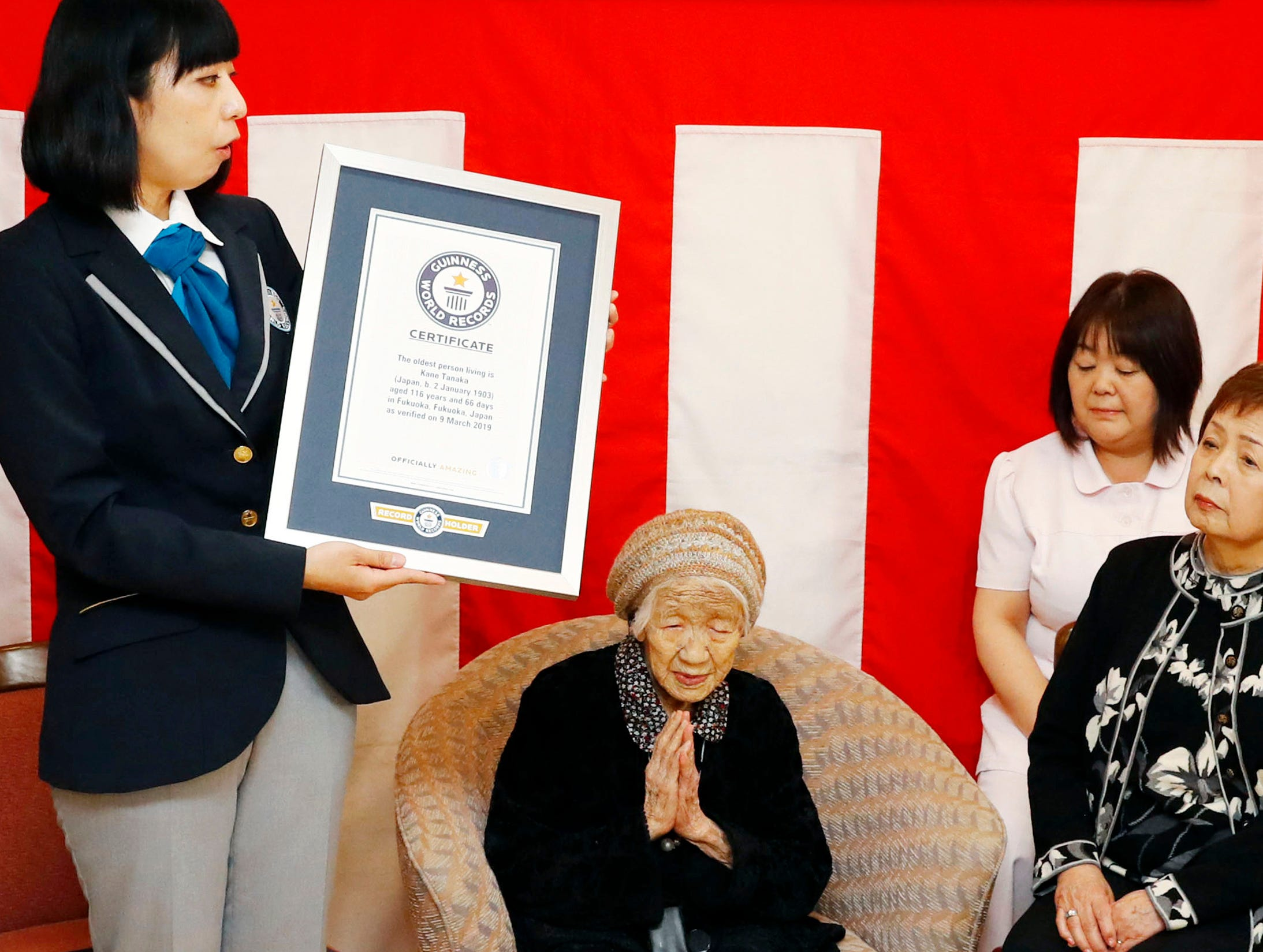Kane Tanaka, a 116-year-old Japanese woman, puts her hands together as she receives a Guinness World Records certificate at a nursing home where she lives during a ceremony in Fukuoka, Japan on Saturday, March 9, 2019. Tanaka who loves playing the board game Othello was honored Saturday as the world's oldest living person by Guinness World Records.