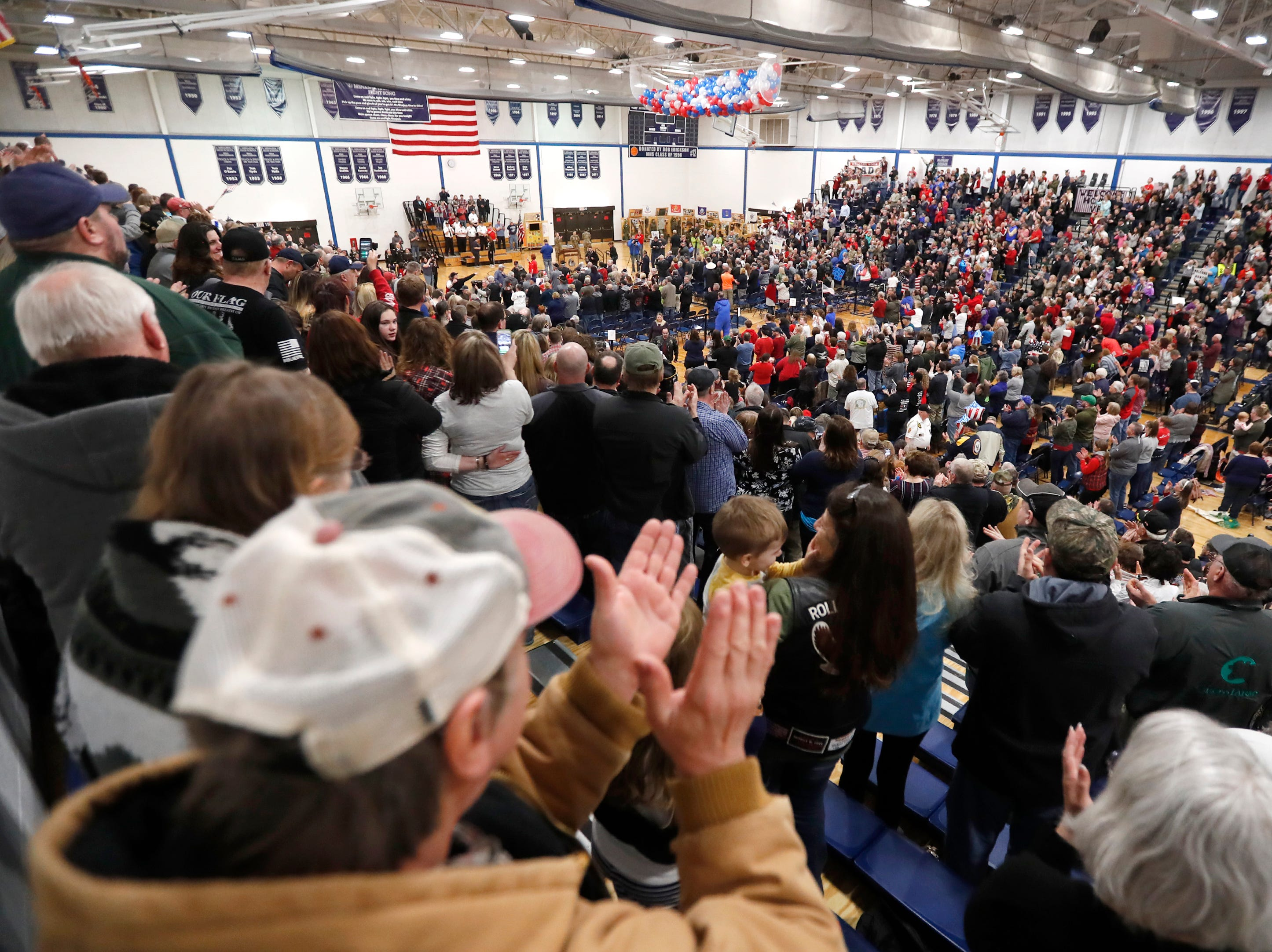 A full gym applauds veterans during the Old Glory Honor Flight-Return to Nam welcome home Saturday, March 9, 2019, at Menasha High School in Menasha, Wis. Veterans were greeted by friends, family, the Menasha High School band, and the 484th Army Band.Danny Damiani/USA TODAY NETWORK-Wisconsin