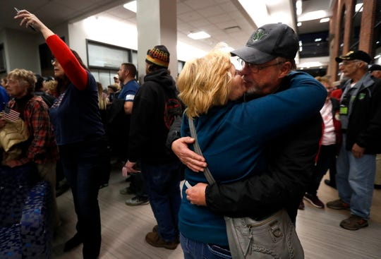 Dick Furman kisses his wife Joanne, of New London, during the Old Glory Honor Flight-Return to Nam welcome home Saturday, March 9, 2019, at Menasha High School in Menasha, Wis. Veterans were greeted by friends, family, the Menasha High School band, and the 484th Army Band. The couple was married in 1971 just before Dick went to Vietnam.