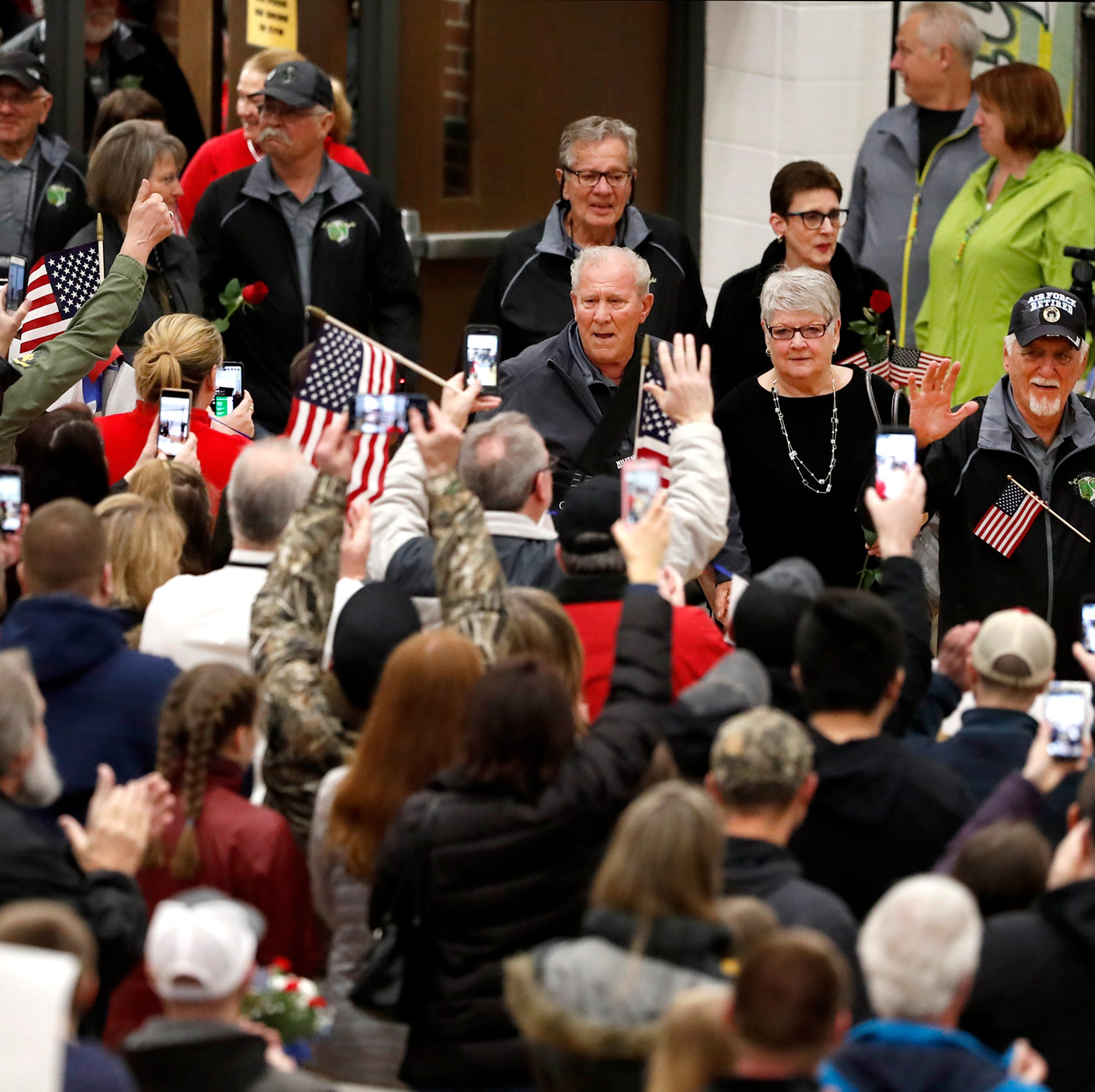 Veterans return to packed celebration after two-week trip back to Vietnam