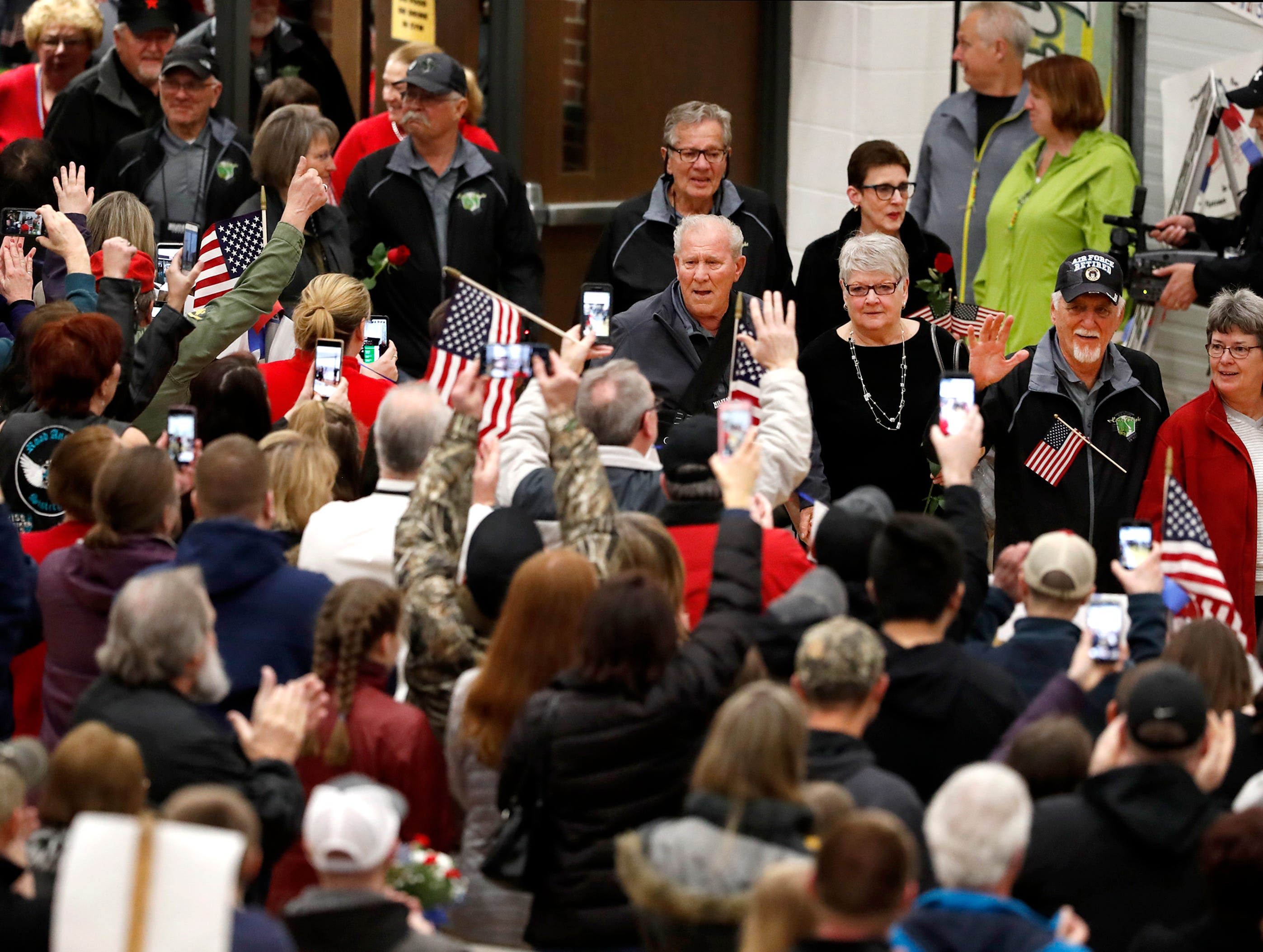 Vietnam veterans are greeted by a crowd of people during the Old Glory Honor Flight-Return to Nam welcome home Saturday, March 9, 2019, at Menasha High School in Menasha, Wis. Veterans were greeted by friends, family, the Menasha High School band, and the 484th Army Band.Danny Damiani/USA TODAY NETWORK-Wisconsin