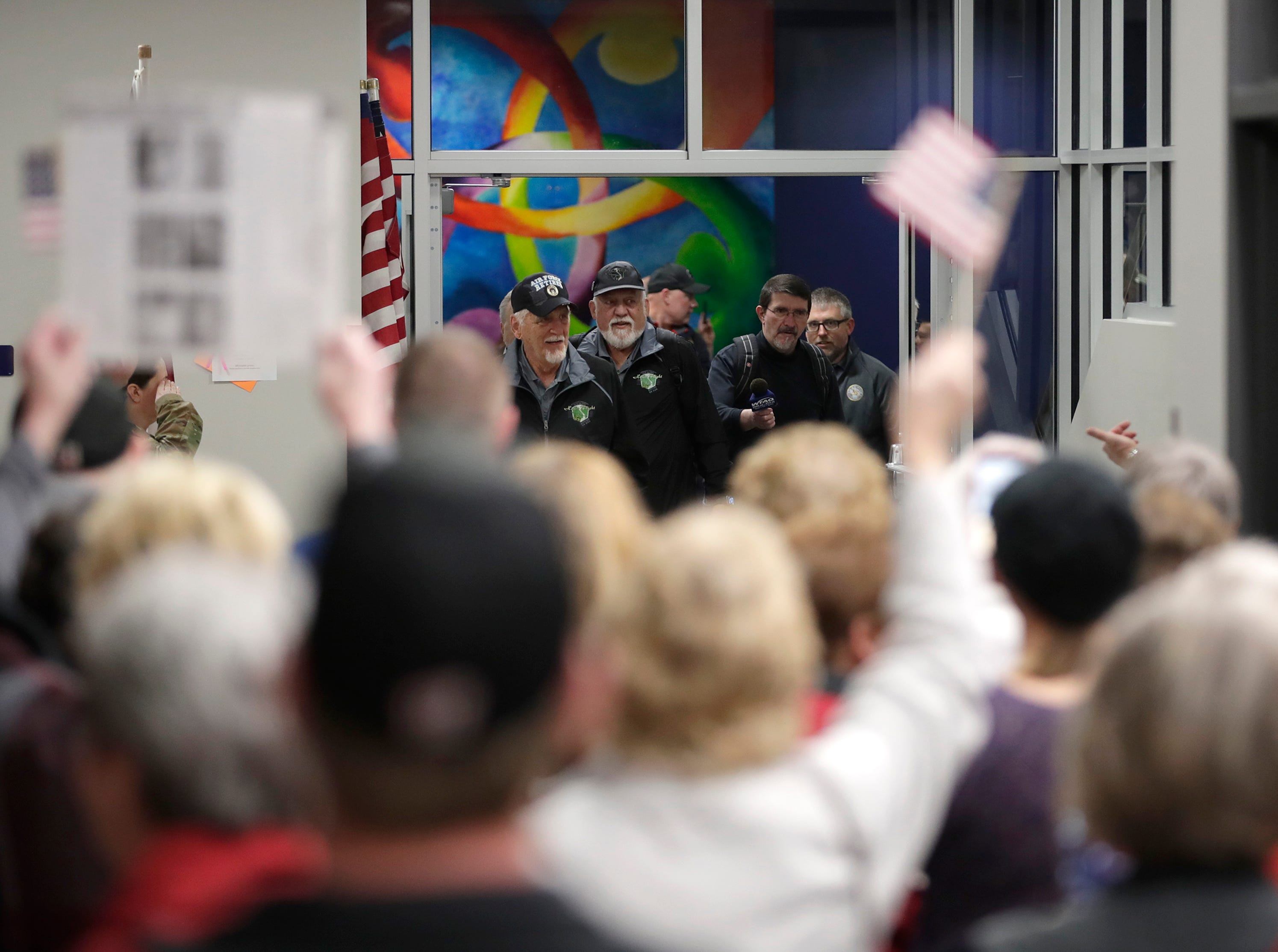 Vietnam veterans are greeted by loved ones during the Old Glory Honor Flight-Return to Nam welcome home Saturday, March 9, 2019, at Menasha High School in Menasha, Wis. Veterans were greeted by friends, family, the Menasha High School band, and the 484th Army Band.Danny Damiani/USA TODAY NETWORK-Wisconsin
