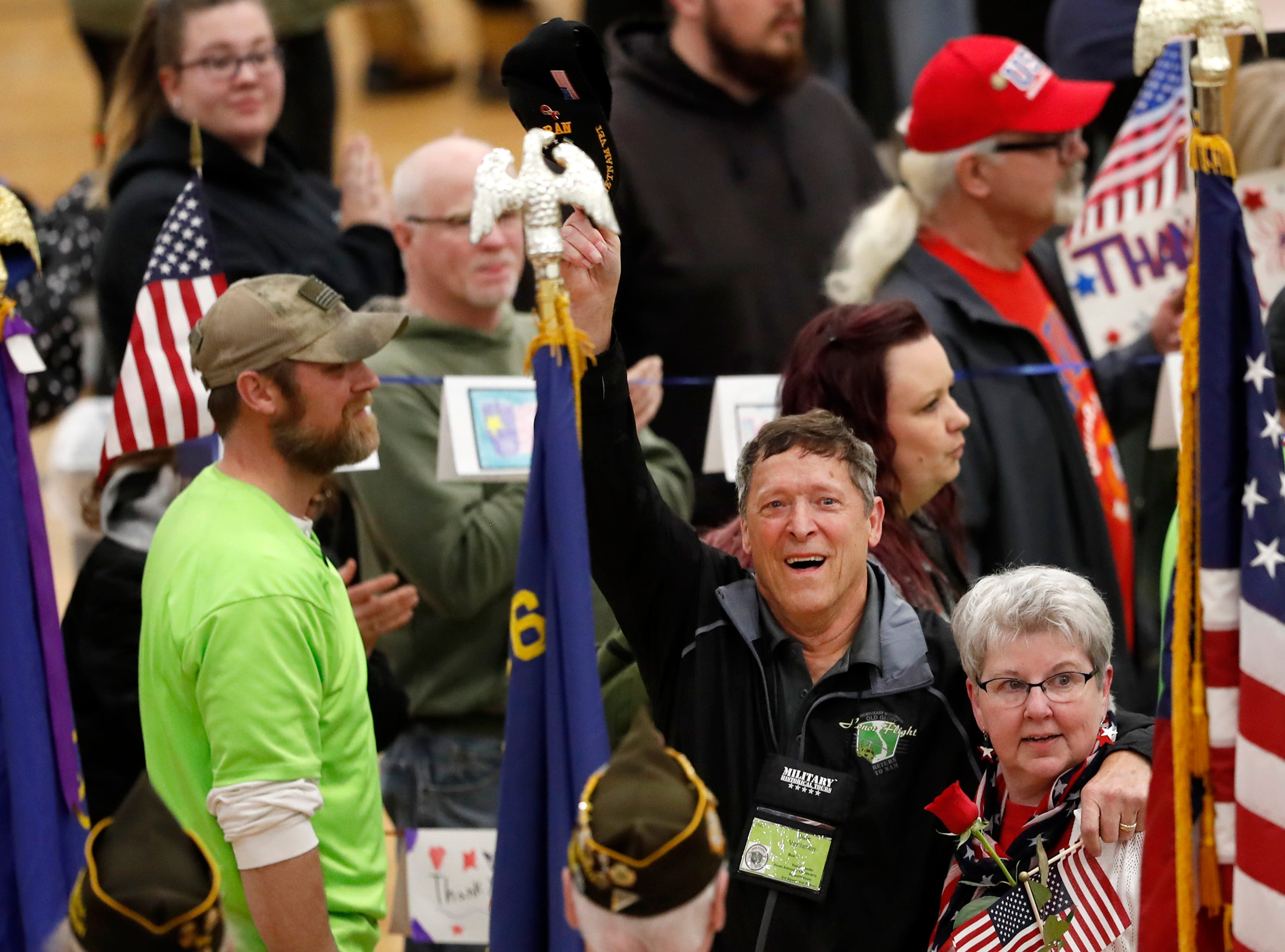 Dale Vanlanen raises his hat to the crowd as he walks to his seat during the Old Glory Honor Flight-Return to Nam welcome home Saturday, March 9, 2019, at Menasha High School in Menasha, Wis. Veterans were greeted by friends, family, the Menasha High School band, and the 484th Army Band.Danny Damiani/USA TODAY NETWORK-Wisconsin
