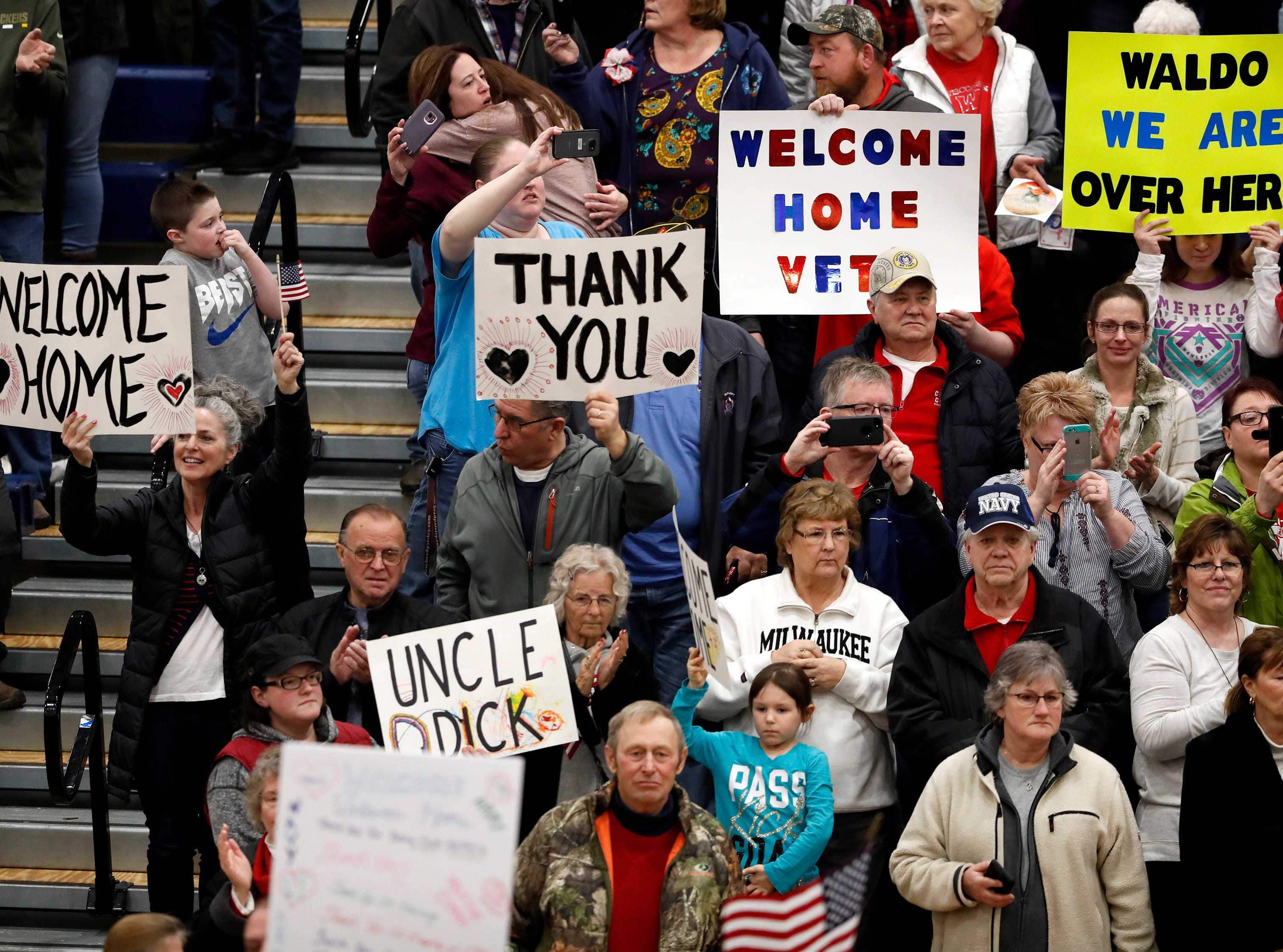 Signs for returning veterans during the Old Glory Honor Flight-Return to Nam welcome home Saturday, March 9, 2019, at Menasha High School in Menasha, Wis. Veterans were greeted by friends, family, the Menasha High School band, and the 484th Army Band.Danny Damiani/USA TODAY NETWORK-Wisconsin