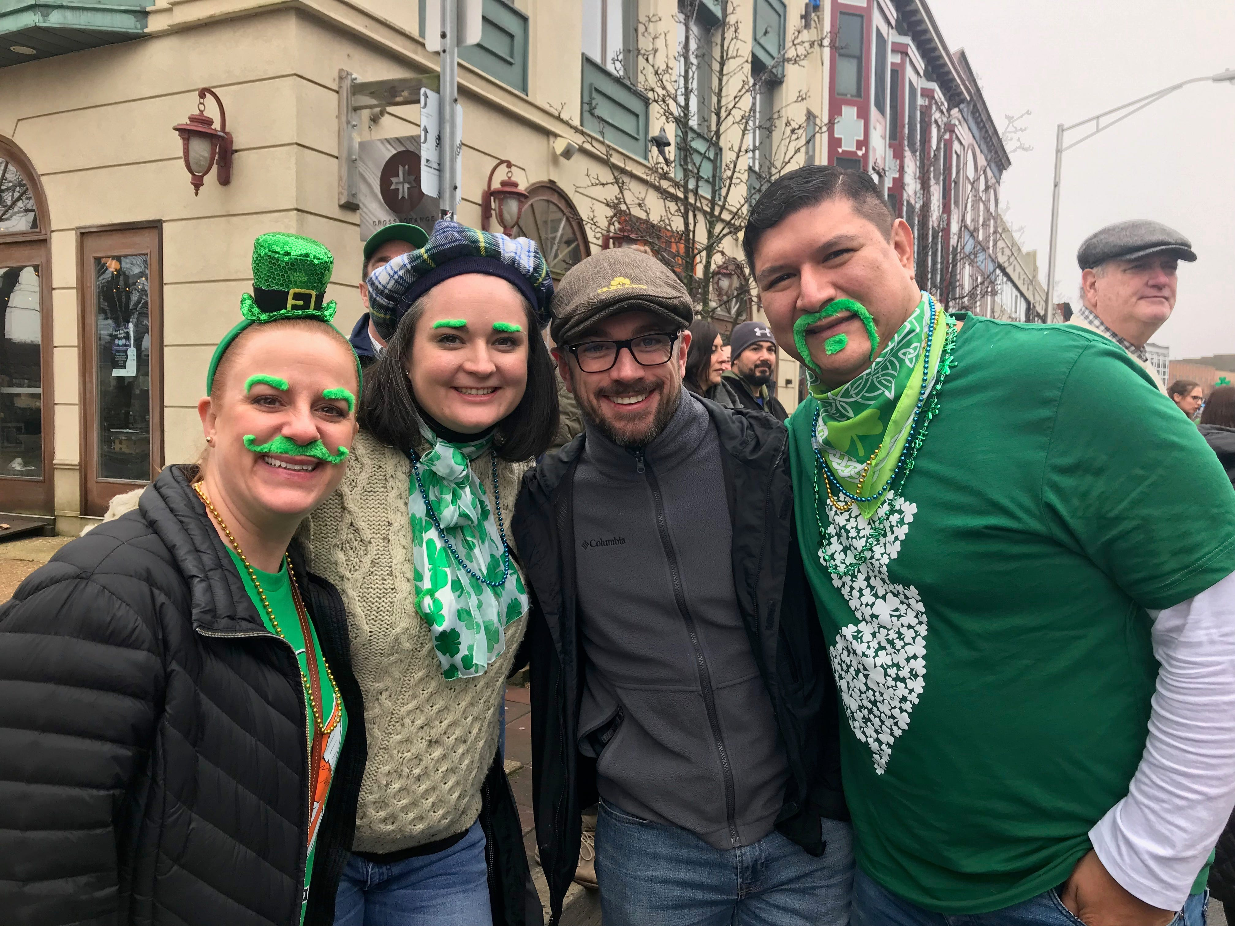From left: Liz Thompson, Alexis Fulks, Kris Fulks and Ray Thompson, all of Tinton Falls, watch the St. Patrick's Day Parade in Asbury Park from Cookman Avenue on March 10, 2019.