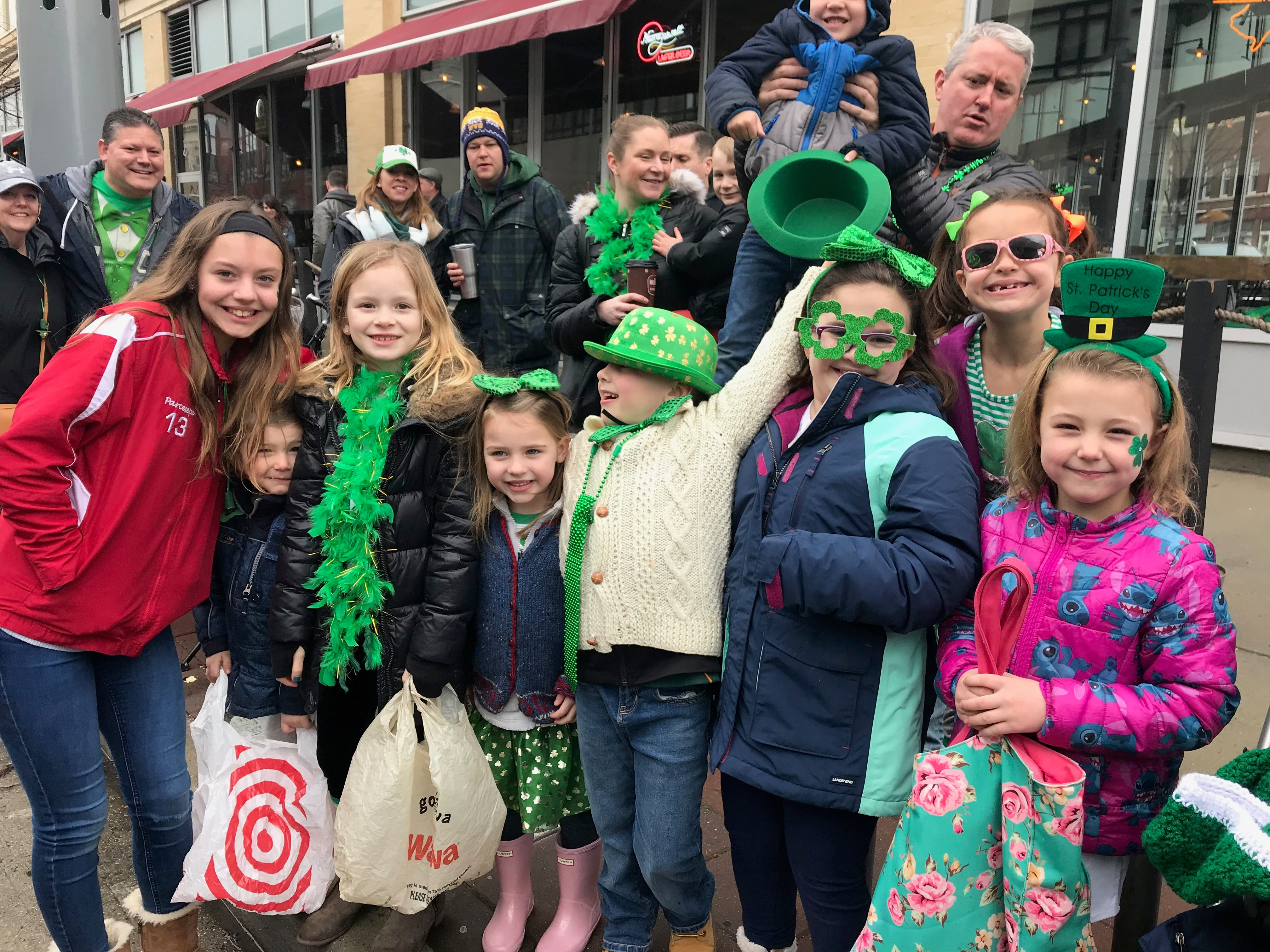 Spectators line Cookman Avenue for the Asbury Park St. Patrick's Day Parade on March 10, 2019.