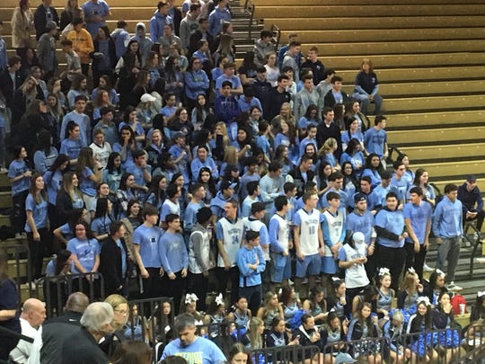 The Freehold Township student section cheers on their team in the Group IV State Final on March 10, 2019 at Rutgers University.