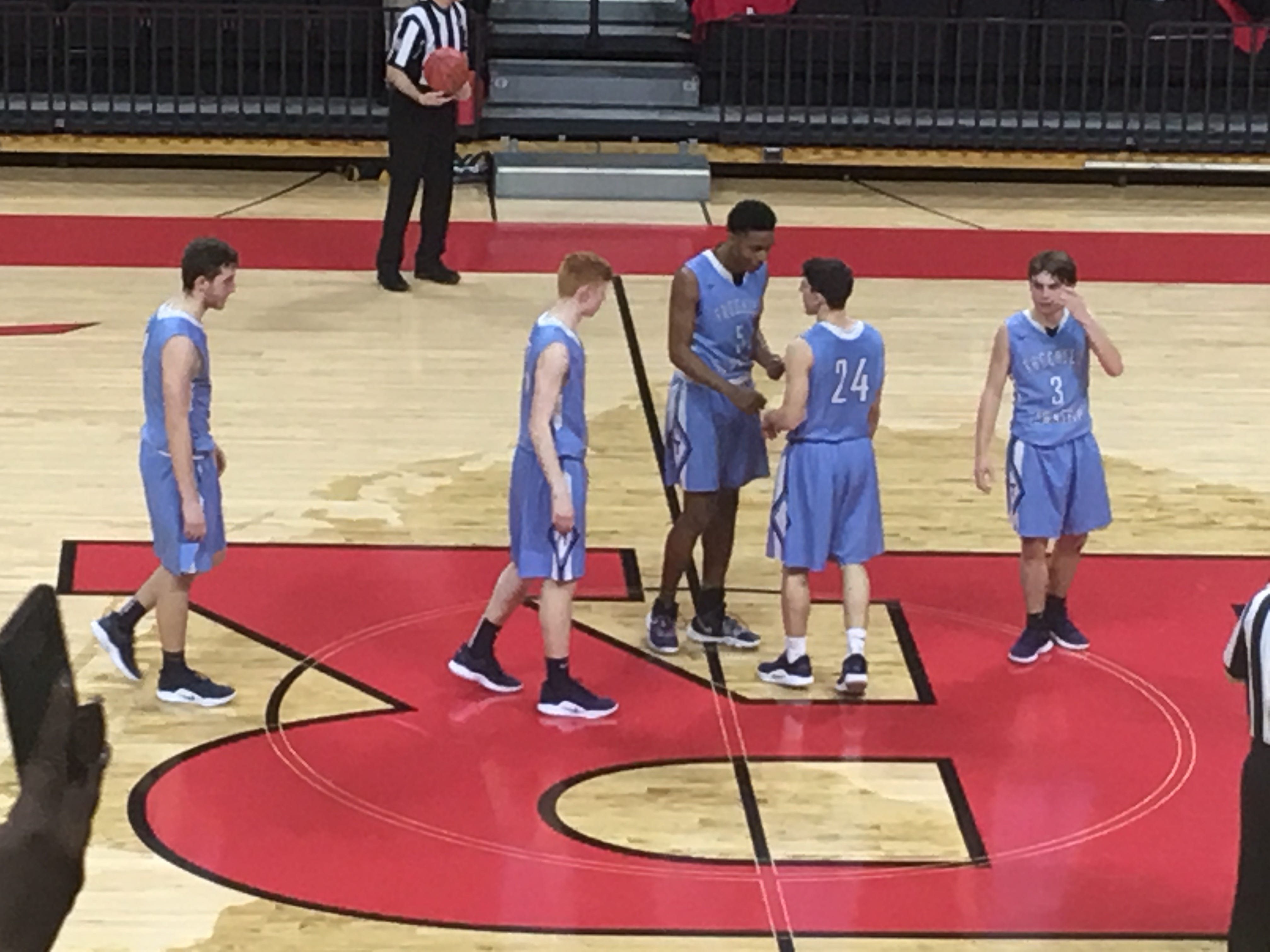 The Freehold Township boys basketball team discusses strategy to start the 3rd quarter in the Group IV State Final at Rutgers University on March 10, 2019