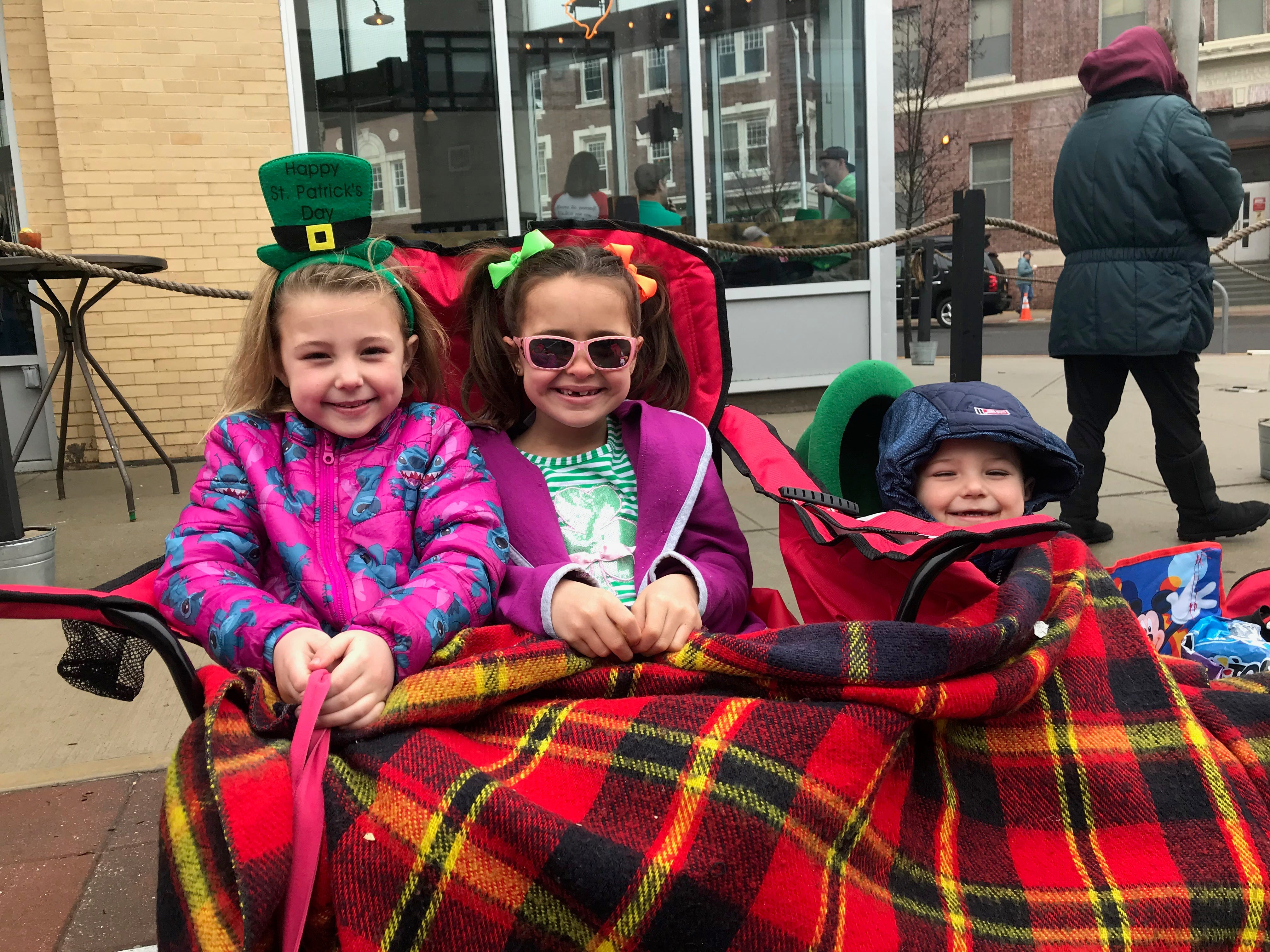 From left: Grace Ratyniak, 6, of Wall; Raeanne Molinelli, 7, of Ocean Township; and Eddie Ratyniak, 4, of Wall wait for the Asbury Park St. Patrick's Day Parade to start on Cookman Avenue.