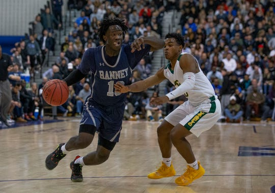 Ahmad Robinson tries to get past Ahmad Robinson during second half action. Ranney Boys Basketball vs Roselle Catholic in Non-Public B Final in Toms River, NJ on March 9, 2019.