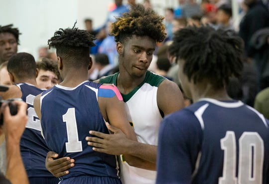 Kahlil Whitney and his team mates hug and shake hands with Ranney team at end of game. Ranney Boys Basketball vs Roselle Catholic in Non-Public B Final in Toms River, NJ on March 9, 2019.