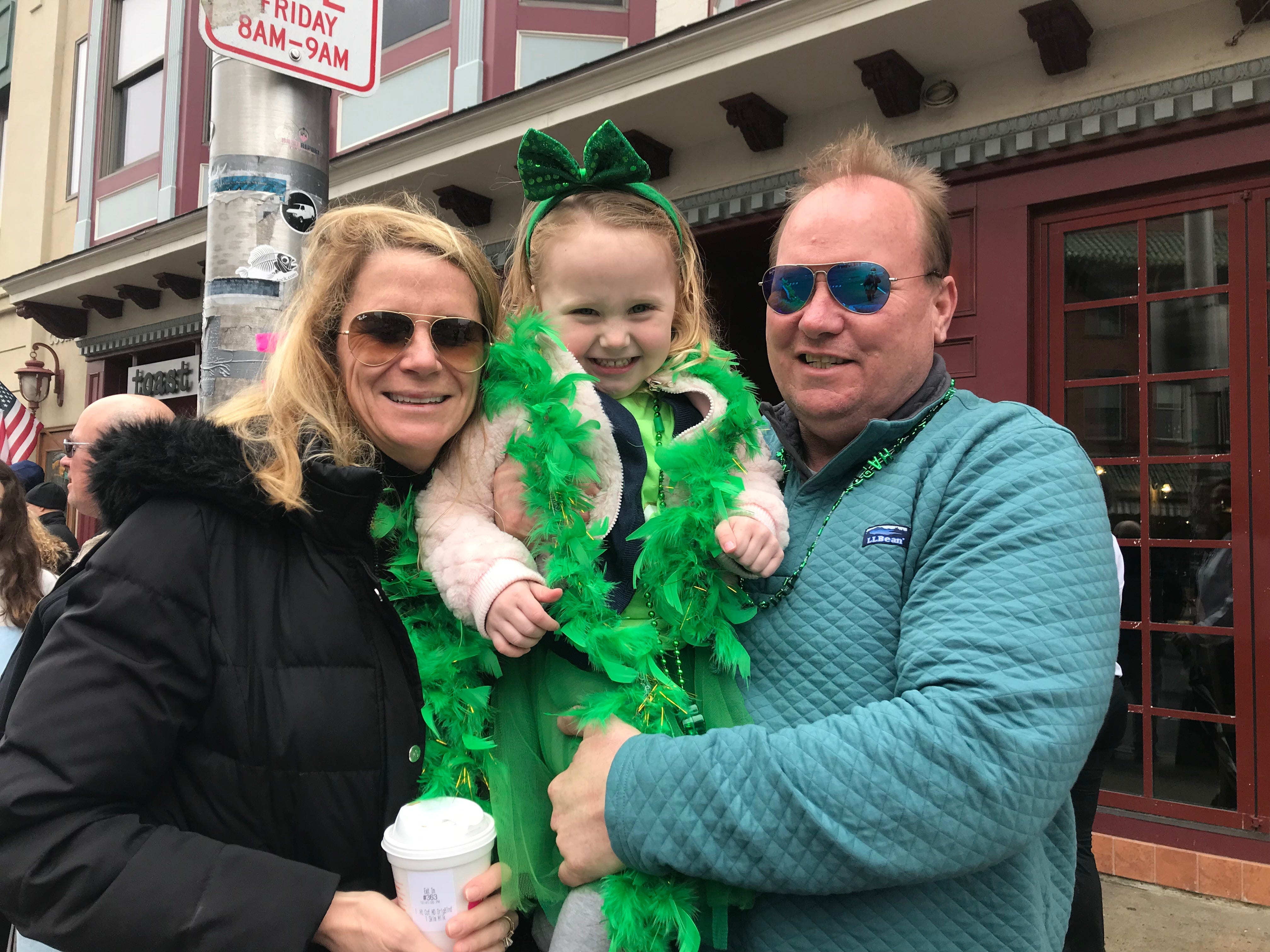Tara and Tim Chenoweth of Tinton Falls, along with 3-year-old Harper, attend the Asbury Park St. Patrick's Day Parade on March 10, 2019.