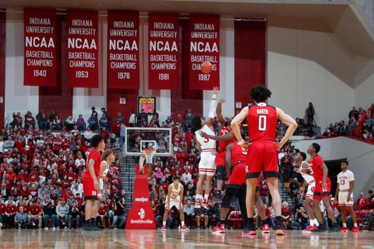 Indiana Hoosiers square off for the opening jump ball against the Rutgers Scarlet Knights during the first half at Assembly Hall.