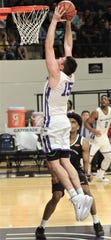 ACU's Hayden Farquhar sails for a dunk while an Incarnate Word defender looks on. ACU beat the Cardinals 81-51 in the regular-season finale Saturday, March 9, 2019, at Moody Coliseum.