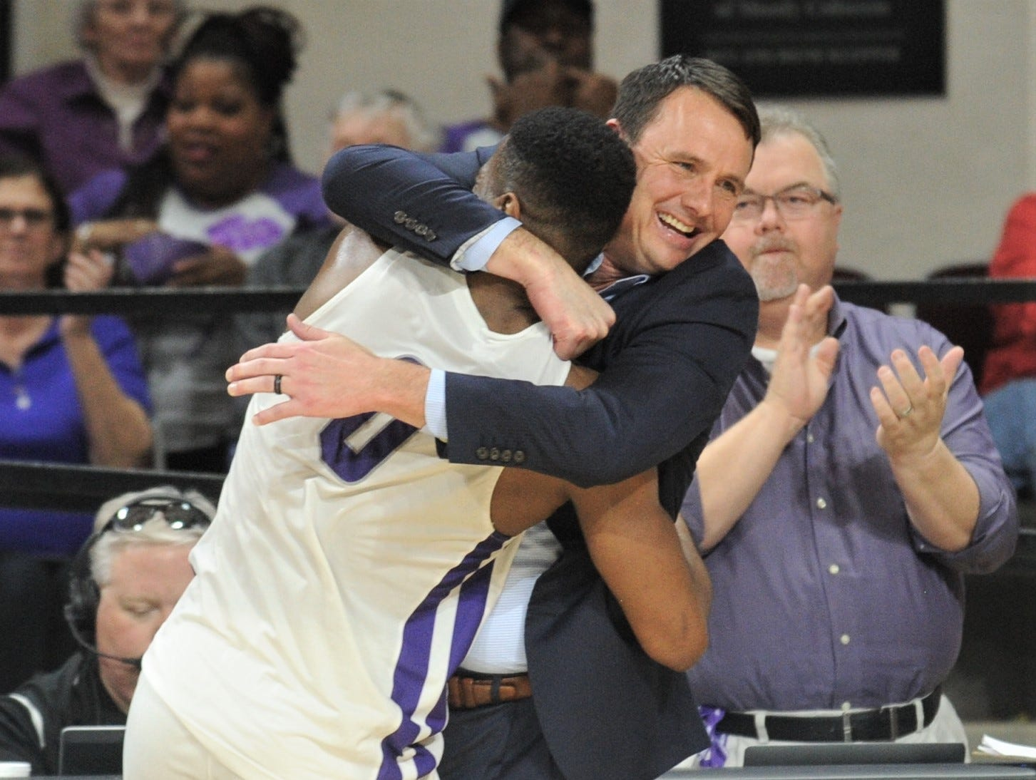 ACU coach Joe Golding, right, gives senior Jaylen Franklin a hug after Franklin leaves the court in his final game at Moody Coliseum. He scored a game-high 19 points as ACU beat Incarnate Word 81-51 in the Southland Conference game Saturday, March 9, 2019, at Moody Coliseum.