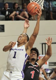 ACU's Jaren Lewis, left, goes for a layup as Incarnate Word's Antoine Smith defends. ACU beat the Cardinals 81-51 in the Southland Conference game Saturday, March 9, 2019, at Moody Coliseum.