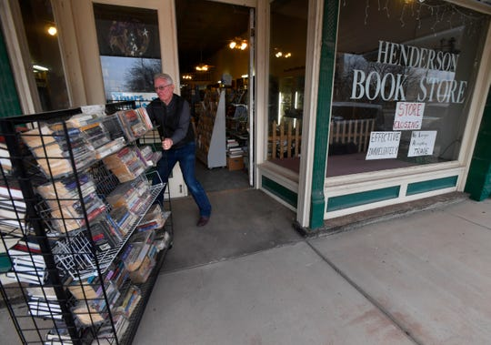 Closing up for the day, Kenneth Jarred pulls a book rack through the front door of Henderson Book Store in Haskell on Friday. The store is located on the west side of the square at No. 3 Ave. E.