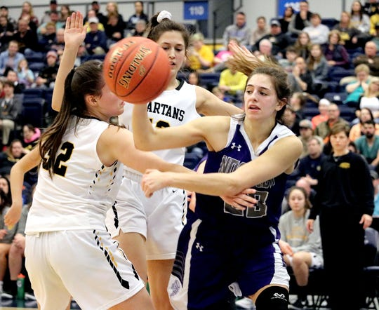 Norwich's Saige Benedict passes out of a double-team of South Jefferson's Taylor Scoville (32) and Emma Schafer during the first half of Saturday's Section 4 Class B quarterfinal at Onondaga Community College.