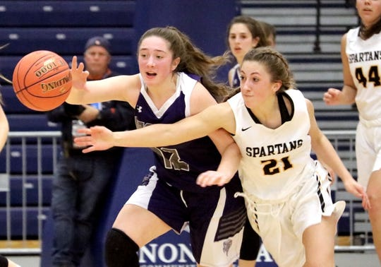 Norwich's Halea Eaton and South Jefferson's Megan Whitley pursue a loose ball during Saturday's Class B state quarterfinal at Onondaga Community College.