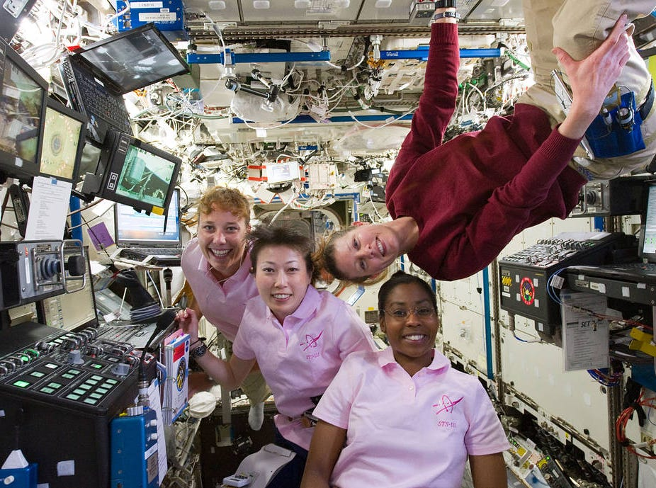 STS-131 mission specialists Stephanie Wilson of NASA, Naoko Yamazaki of the Japanese Aerospace Exploration Agency, Dorothy Metcalf-Lindenburger of NASA, and Expedition 23 flight engineer Tracy Caldwell Dyson (top left) work at the robotics workstation on the International Space Station, April 8, 2010.
