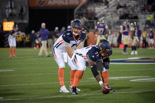 Orlando Apollos quarterback Austin Appleby (5) and offensive lineman Ronald Patrick (71) warm up before an AAF football game against the Atlanta Legends Saturday, Feb. 9, 2019, in Orlando.