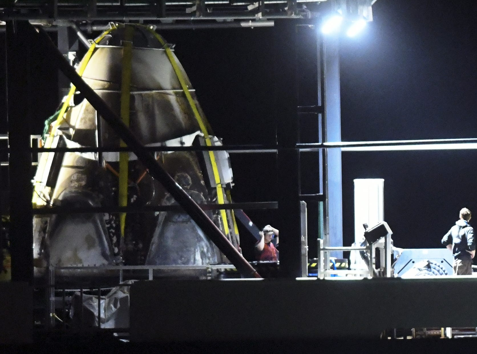 The SpaceX Crew Dragon capsule aboard the support ship Go Searcher, returns to Port Canaveral Saturday evening, March 9, 2019.  The capsule, launched aboard a Falcon 9 rocket last week, made a trip to the International Space Station before returning to Earth.
