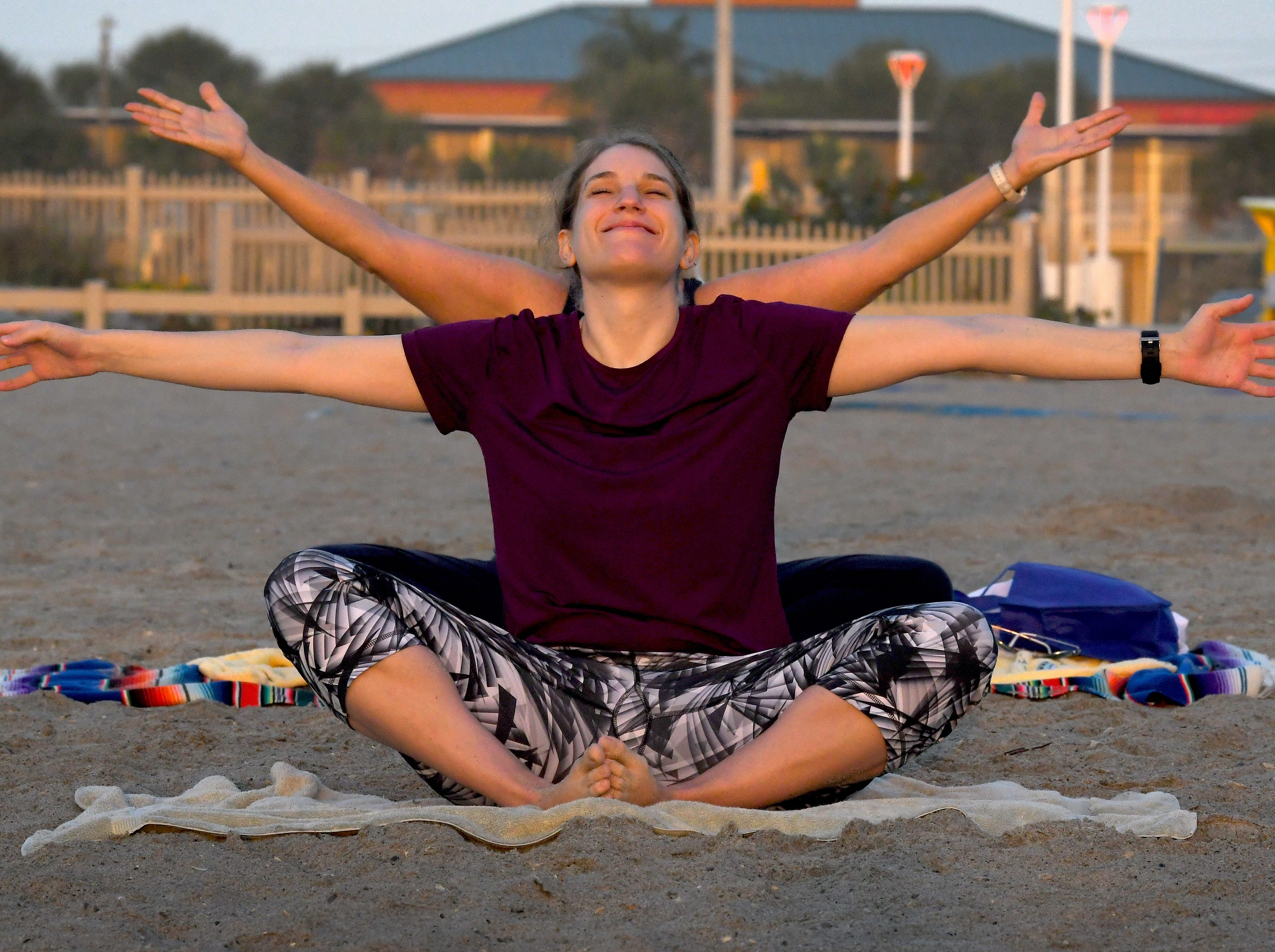 Anne Lee, and behind her is Robin Taylor. Sunrise Celebration Stretch at sunrise next to the Westgate Cocoa Beach Pier on the first day of Daylight Savings. This Yoga group, coordinated by Robin Taylor, meets at other locations as well.