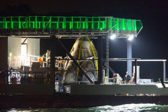 SpaceX's Crew Dragon capsule arrives at Port Canaveral on the company's Go Searcher ship on Saturday, March 9, 2019. It splashed down in the Atlantic after a successful demonstration flight the day before.
