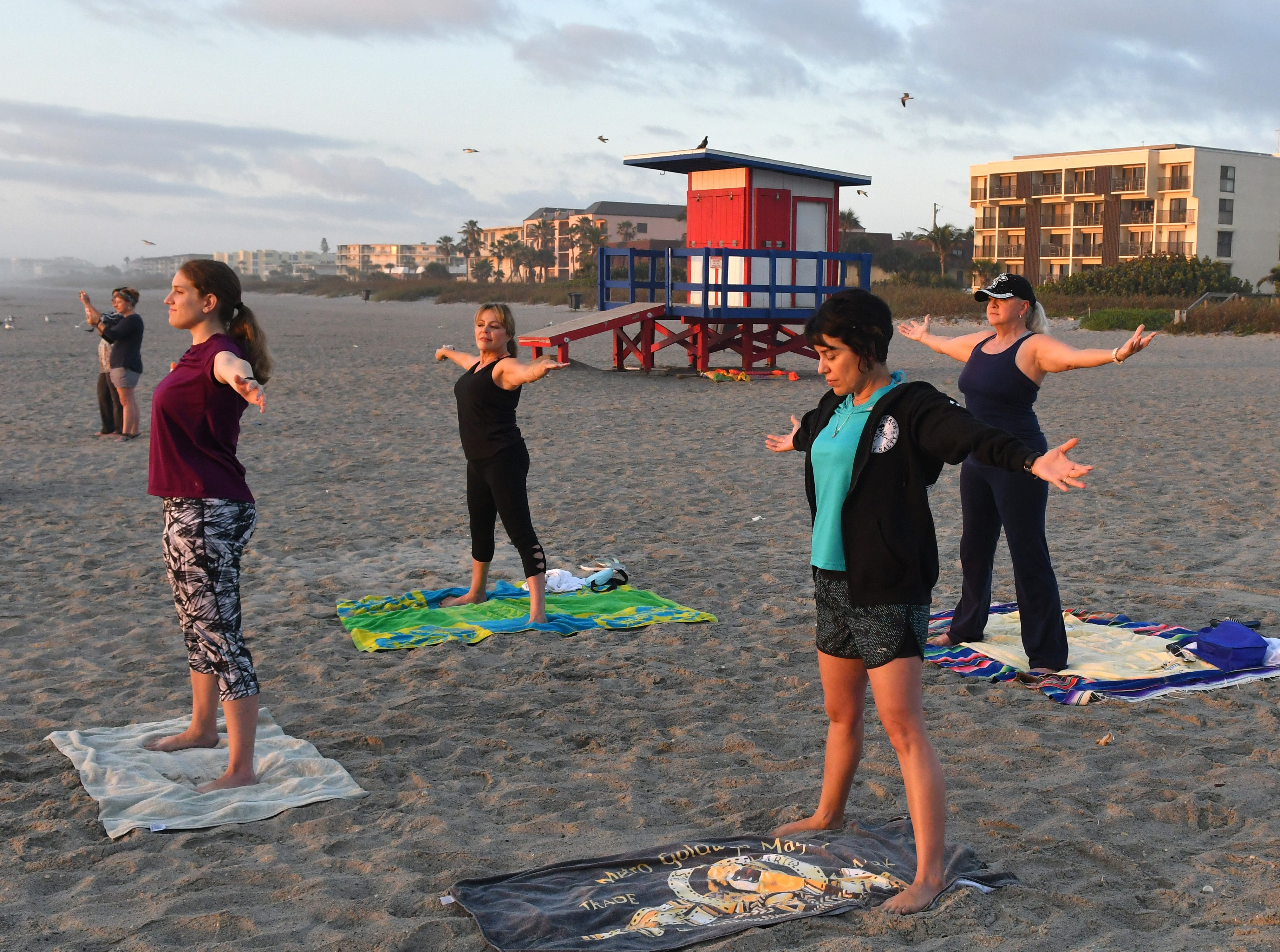 Sunrise Celebration Stretch at sunrise next to the Westgate Cocoa Beach Pier on the first day of Daylight Savings. This Yoga group, coordinated by Robin Taylor, meets at other locations as well.