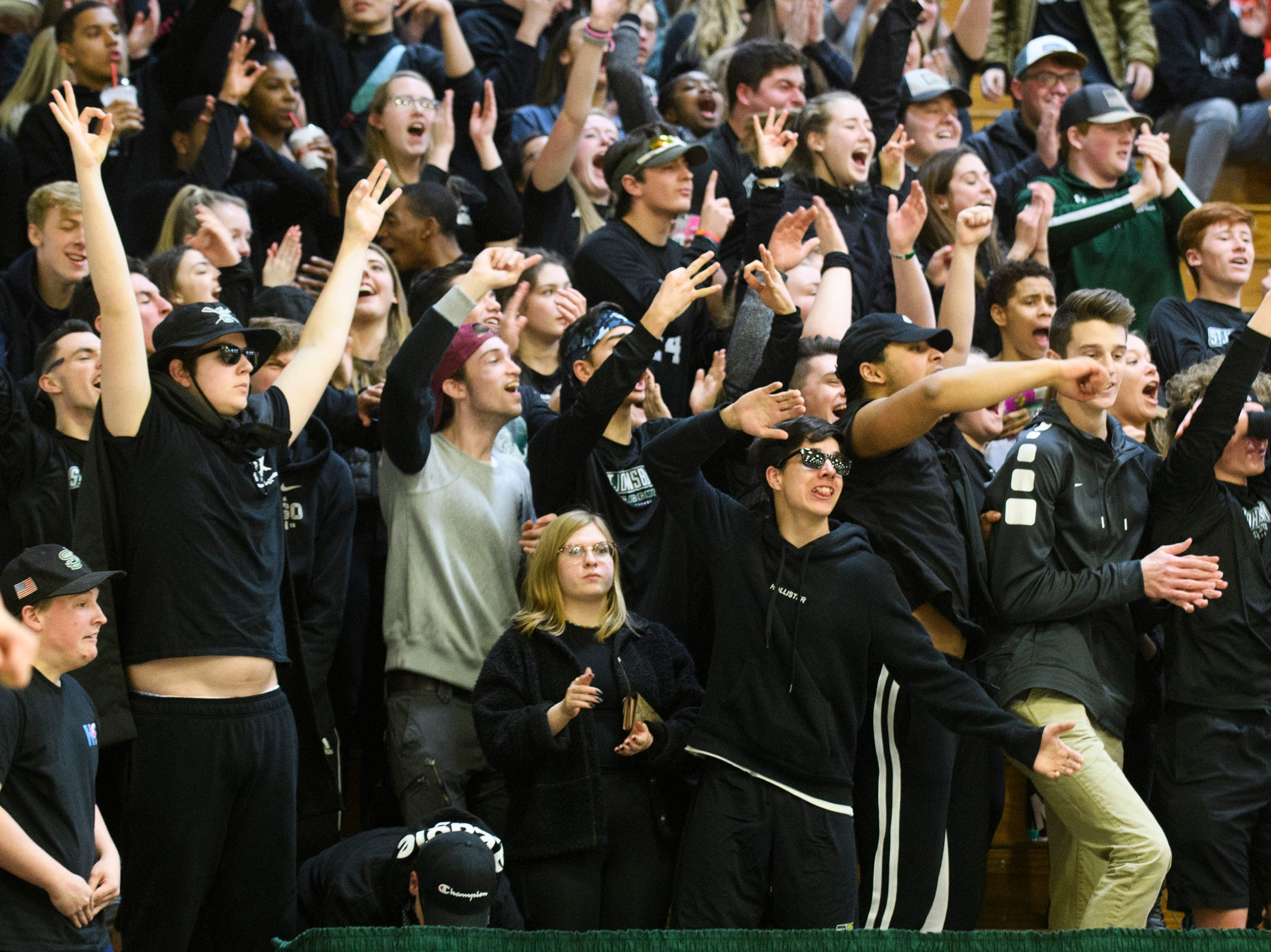 St. Johnsbury fans cheer for the team during the division I girls basketball championship basketball game between the St. Johnsbury Hilltoppers and the Champlain Valley Union Redhawks at Patrick Gym on Sunday afternoon March 10, 2019 in Burlington, Vermont.