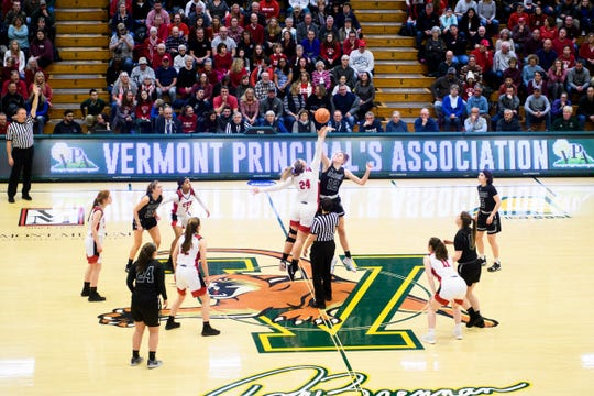 CVU and St. Johnsbury battle for the opening tip off during the division I girls basketball championship basketball game between the St. Johnsbury Hilltoppers and the Champlain Valley Union Redhawks at Patrick Gym on Sunday afternoon March 10, 2019 in Burlington, Vermont.