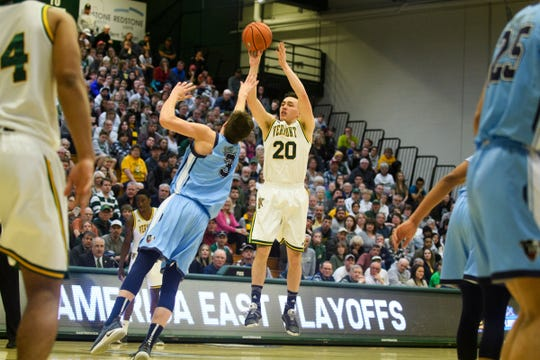Vermont guard Ernie Duncan (20) shoots the ball over Maine's Vilgot Larsson (3) during the America East quarterfinal basketball game between the Maine Black Bears and the Vermont Catamounts at Patrick Gym on Saturday night March 9, 2019 in Burlington, Vermont.