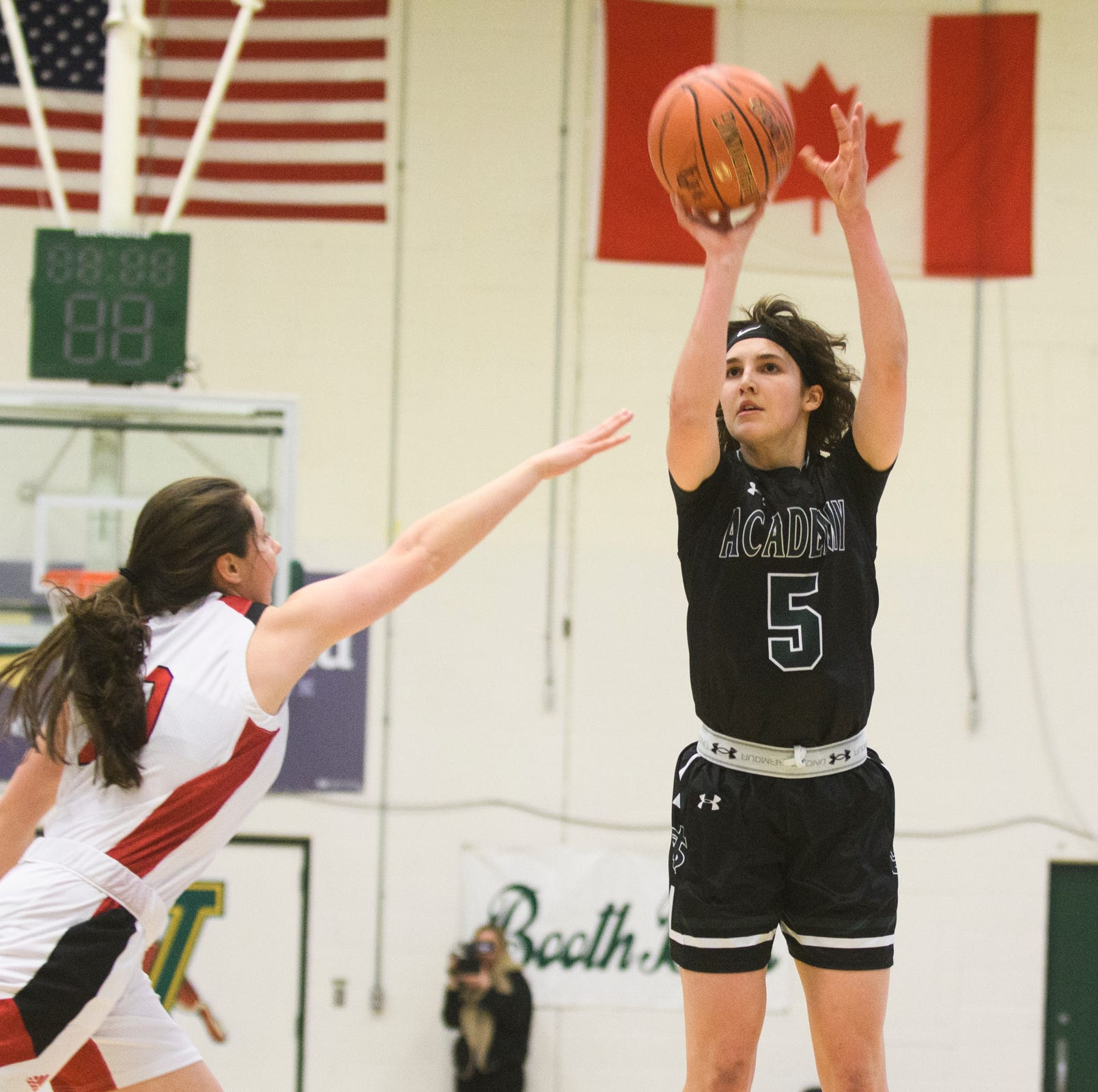 St. Johnsbury's Sadie Stetson (5) shoots the ball during the division I girls basketball championship basketball game between the St. Johnsbury Hilltoppers and the Champlain Valley Union Redhawks at Patrick Gym on Sunday afternoon March 10, 2019 in Burlington, Vermont.