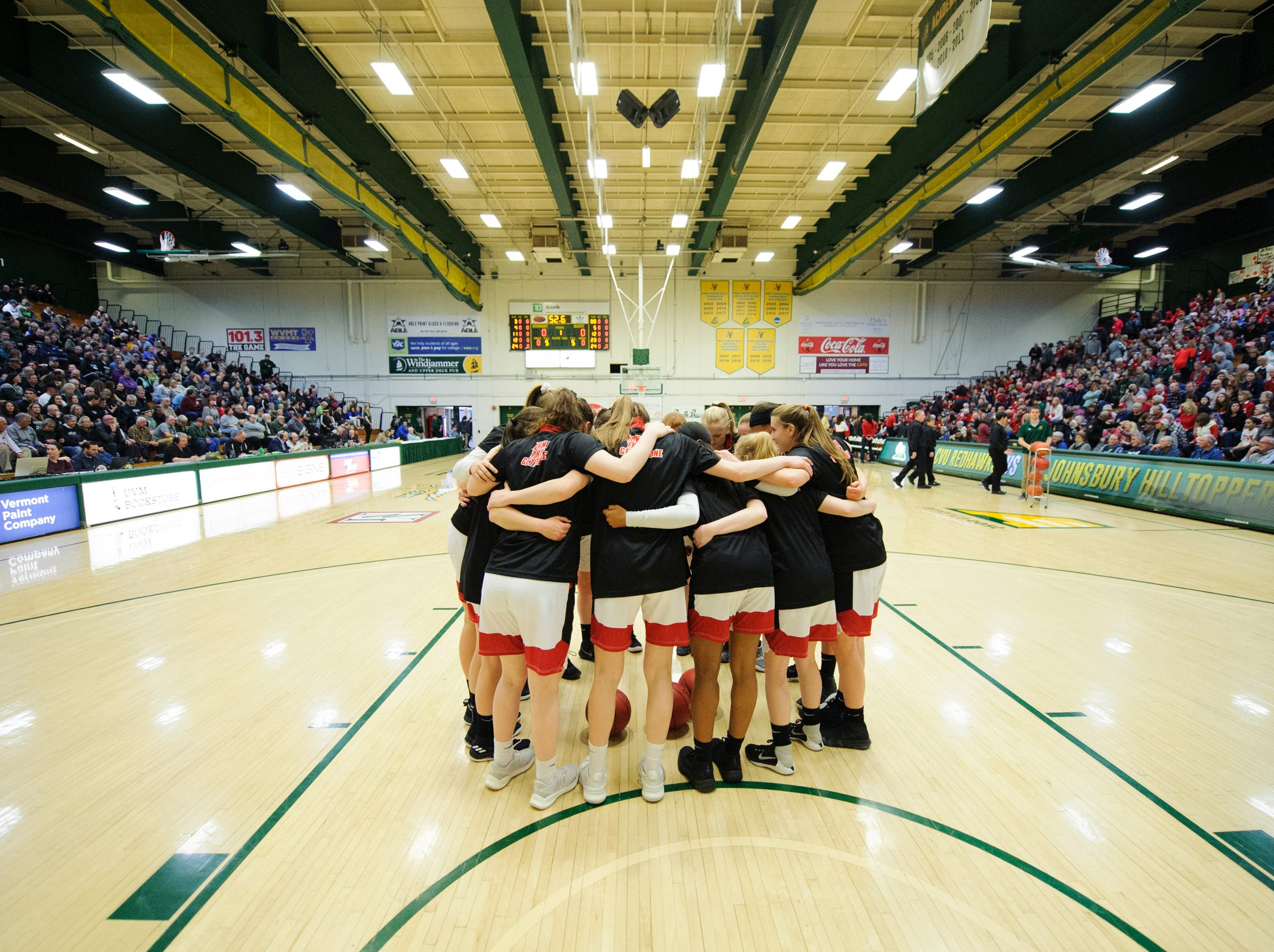 CVU huddles together during the division I girls basketball championship basketball game between the St. Johnsbury Hilltoppers and the Champlain Valley Union Redhawks at Patrick Gym on Sunday afternoon March 10, 2019 in Burlington, Vermont.