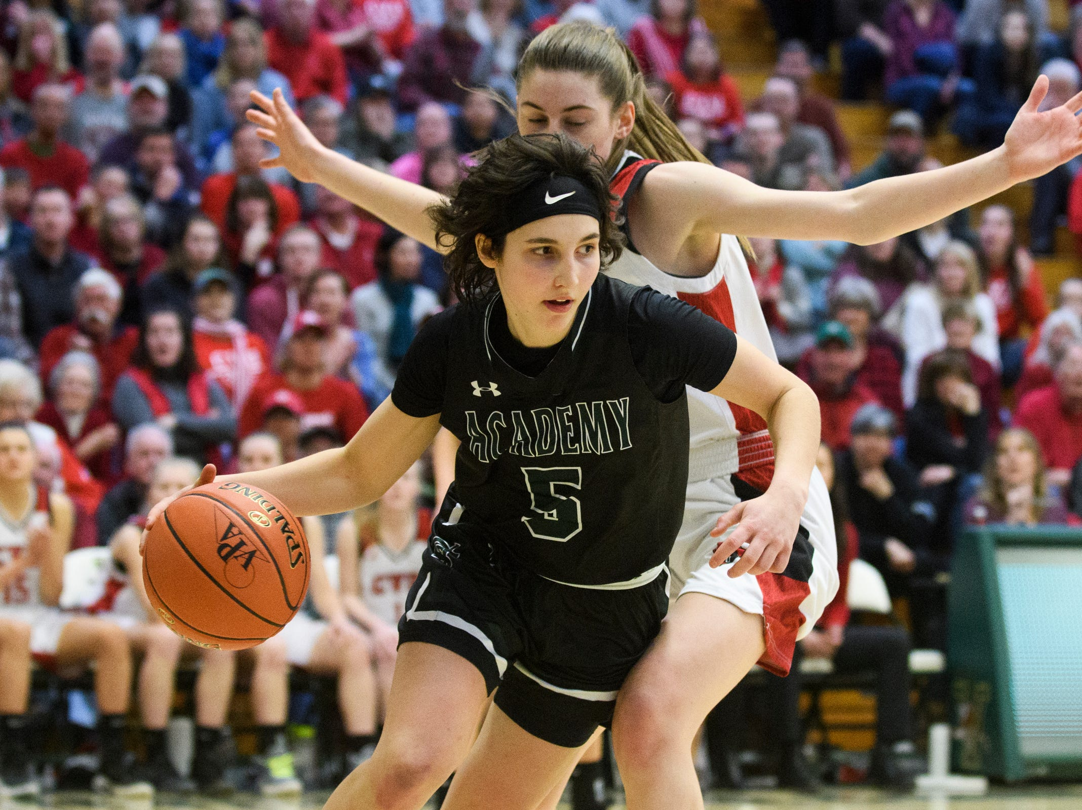 St. Johnsbury's Sadie Stetson (5) drives to the hoop  during the division I girls basketball championship basketball game between the St. Johnsbury Hilltoppers and the Champlain Valley Union Redhawks at Patrick Gym on Sunday afternoon March 10, 2019 in Burlington, Vermont.