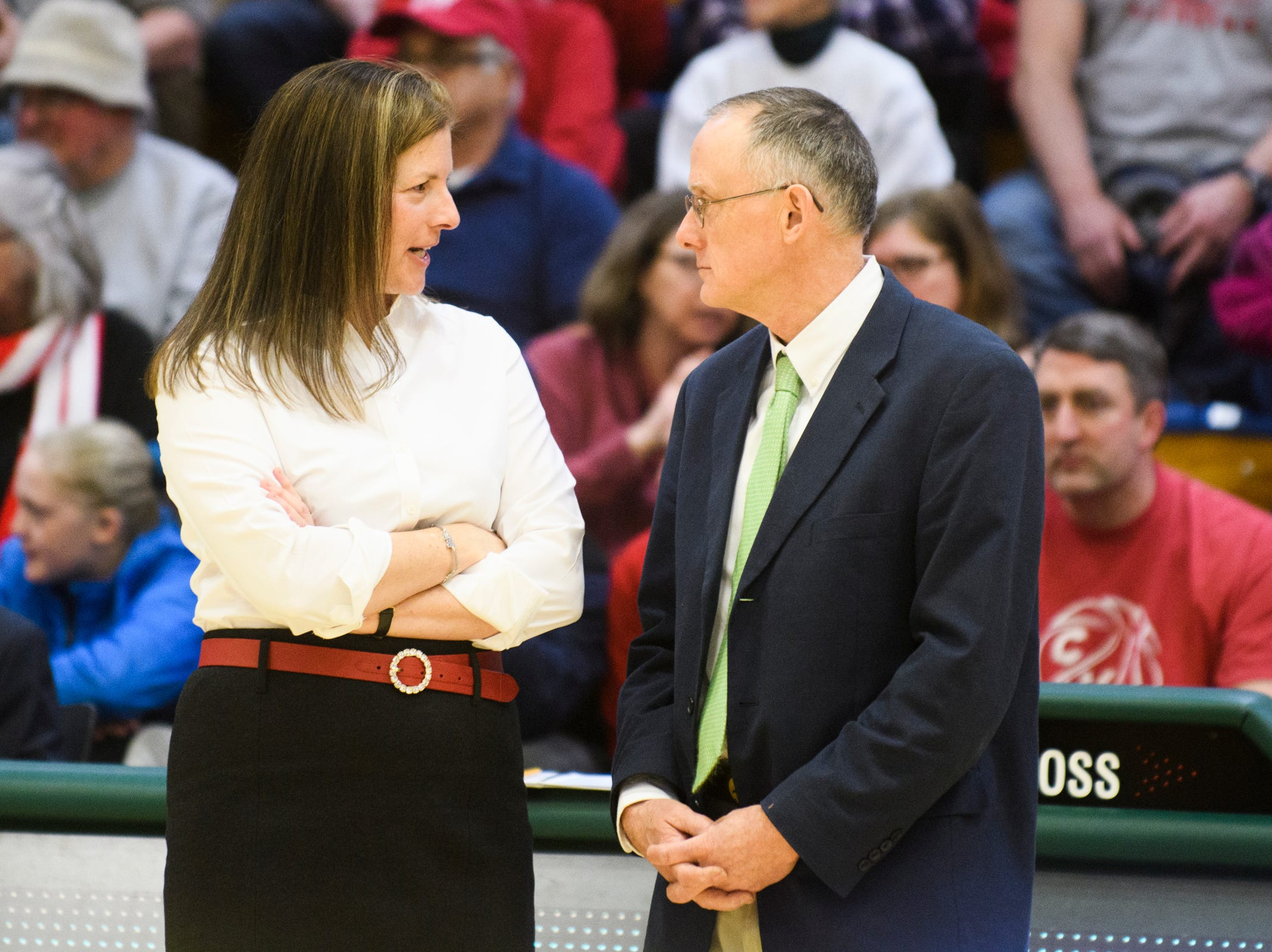 CVU head coach Ute Otley and St. Johnsbury head coach Jack Driscoll talk to each other during the division I girls basketball championship basketball game between the St. Johnsbury Hilltoppers and the Champlain Valley Union Redhawks at Patrick Gym on Sunday afternoon March 10, 2019 in Burlington, Vermont.